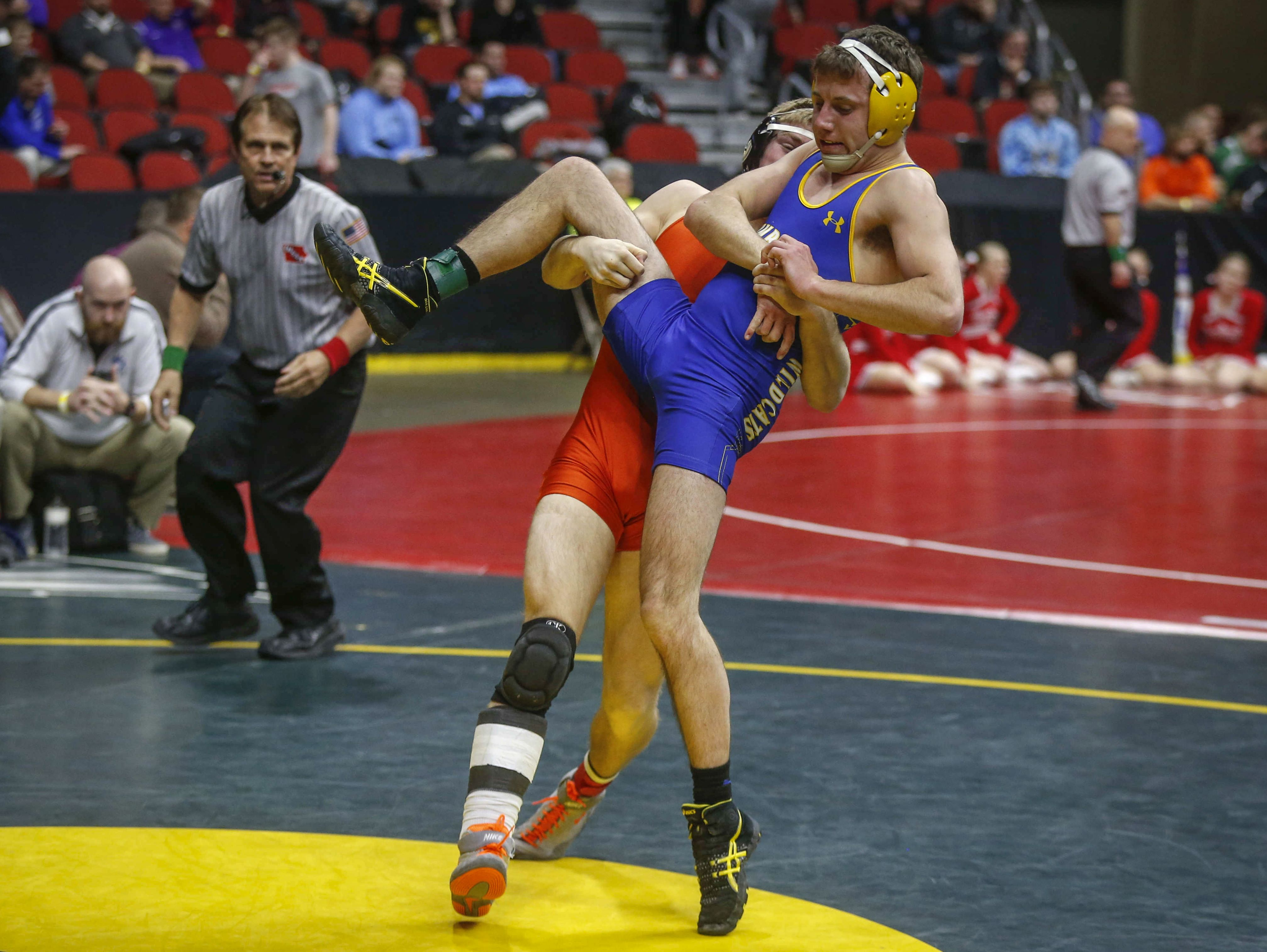 Solon senior Graeson Dall lifts Humboldt senior Jaden Kampen in their match at 152 pounds on Thursday, Feb. 16, 2017, during the Iowa Class 2A state wrestling tournament at Wells Fargo Arena in Des Moines.