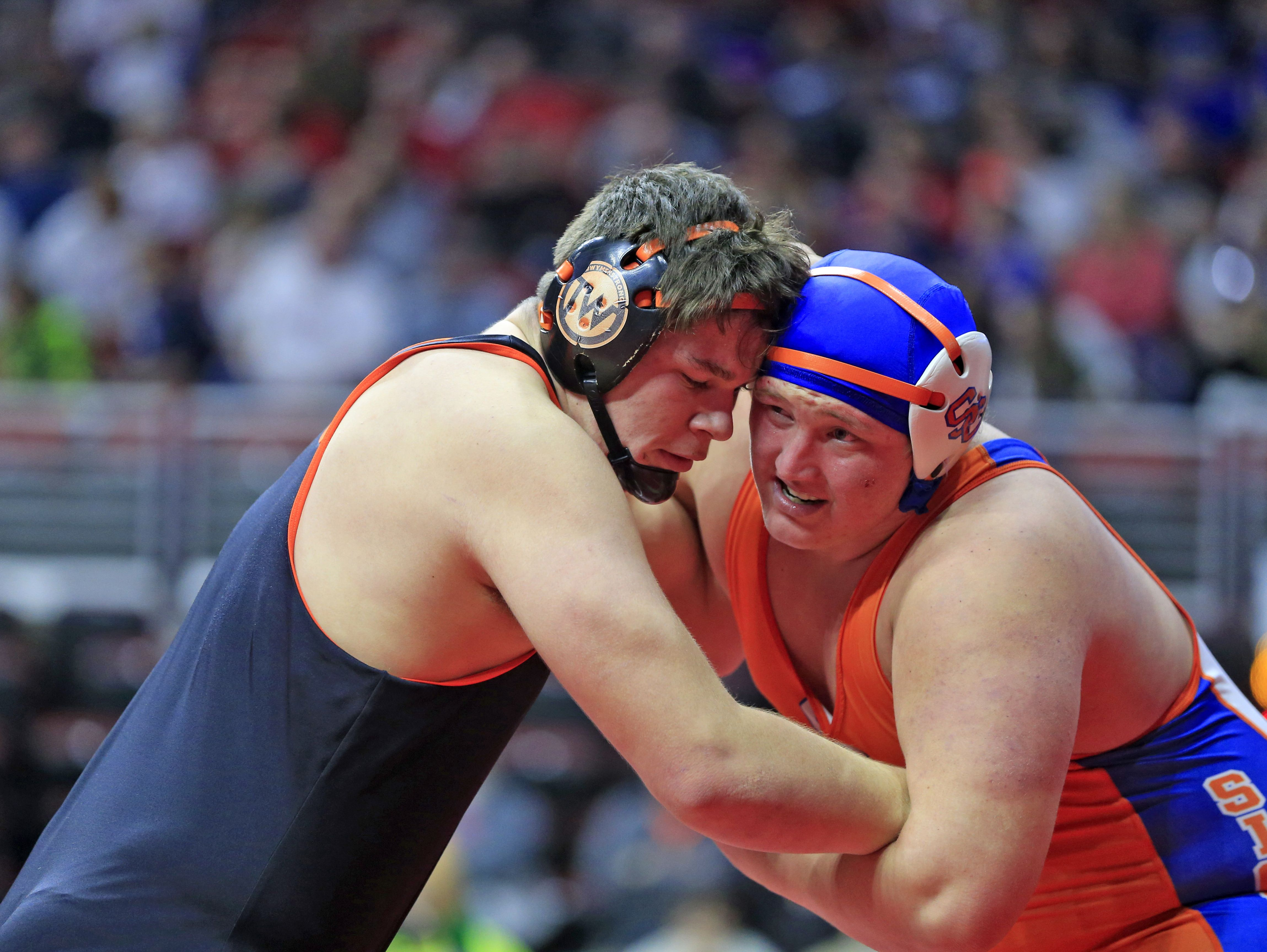 Elijah Van't Hof of Sioux Center wrestles Tyler LinderBaum of Solon at 285 Lbs. Thursday, Feb. 16, 2017.
