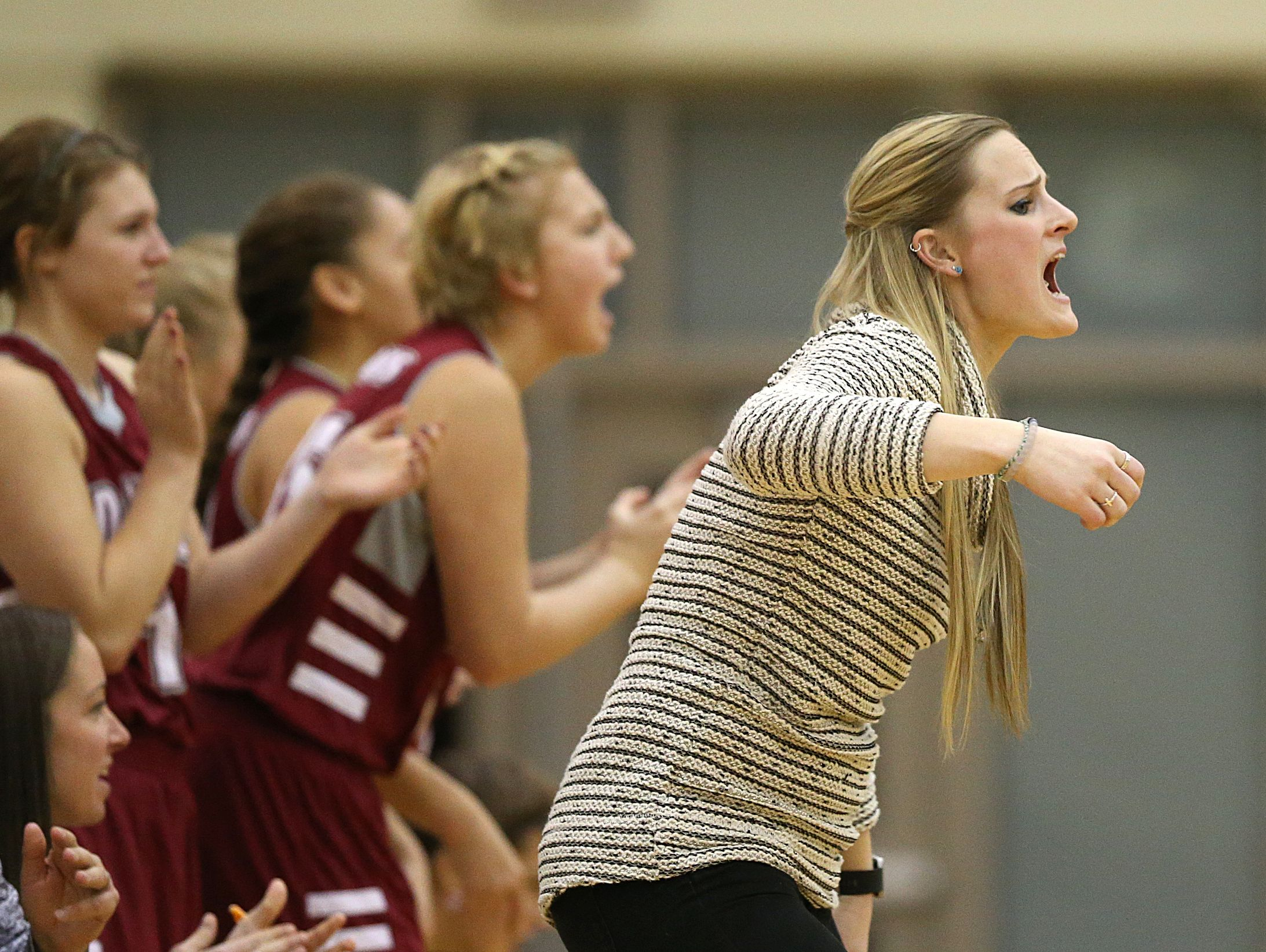 Danville Warriors coach Kaley May shouts at players during second half action of Hendricks County girls basketball finals at Plainfield High School, Jan. 7, 2016.