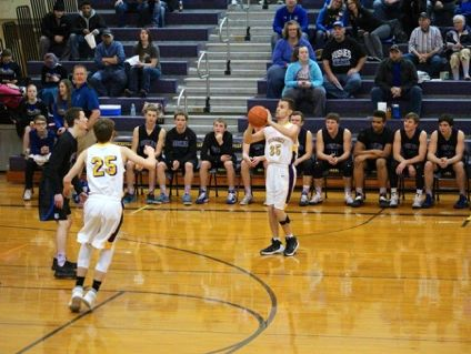 Centerville senior James Brown lines up a 3-pointer against Bridgewater-Emery on Feb. 13, 2017. Brown, who was born with cerebral palsy, scored a game-high 25 points in his final home game as a Tornado.