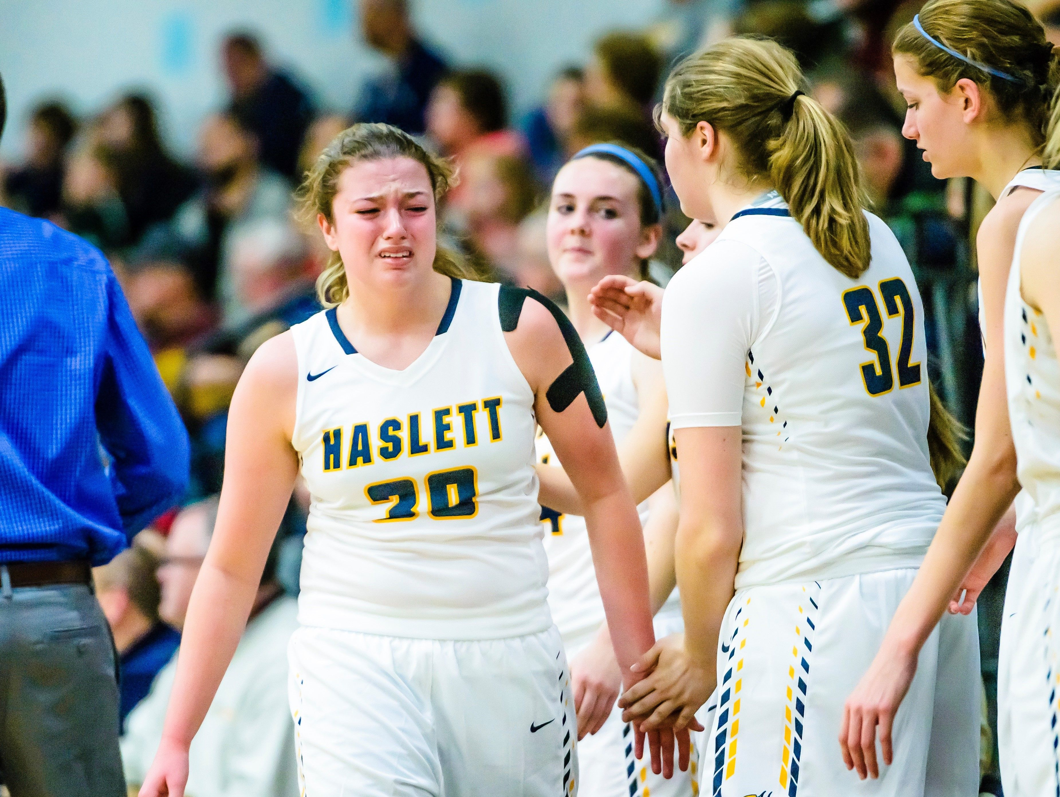 Sydnee Dennis of Haslett reacts late in the 4th quarter after checking out of the Vikings' home finally loss to DeWitt Friday February 17, 2017 in Haslett.