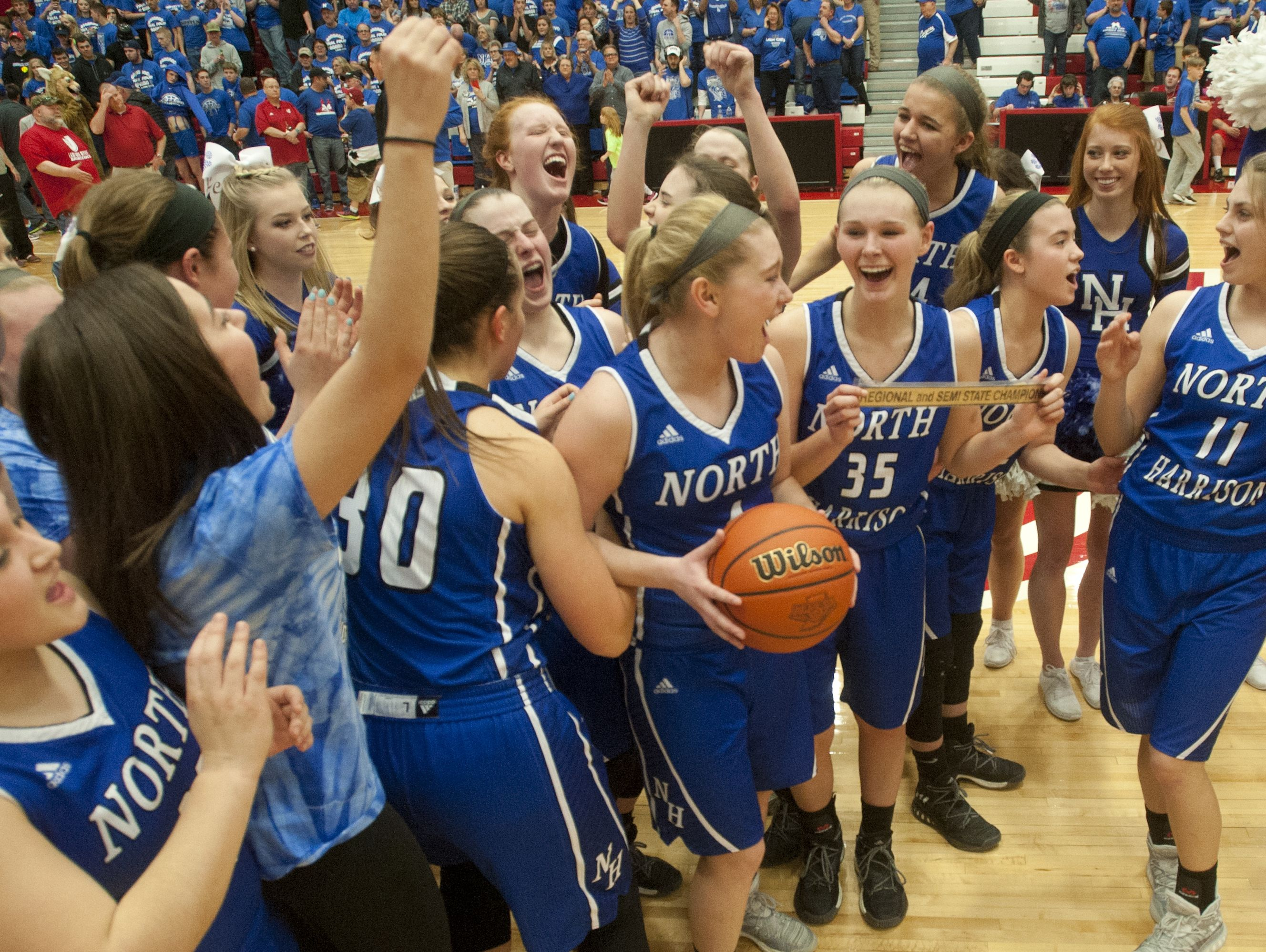 North Harrison celebrates their defeat of Danville (In.,) 65-43, in the IHSAA 3A Girls Basketball Semi-State. 18 February 2017