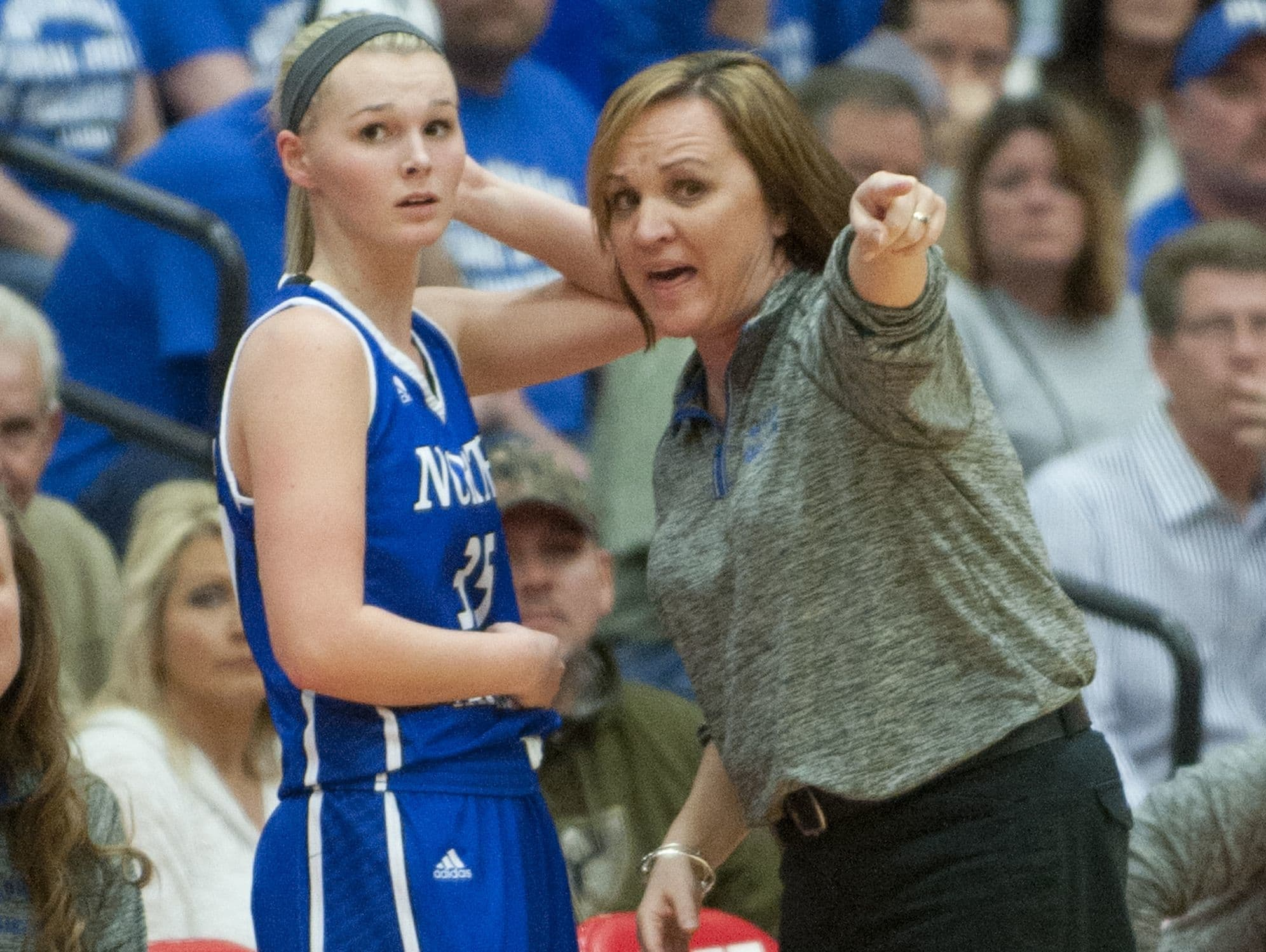 North Harrison guard Stevi Burns gets some instructions from North Harrison head basketball coach Missy Voyles during the game. 18 February 2017