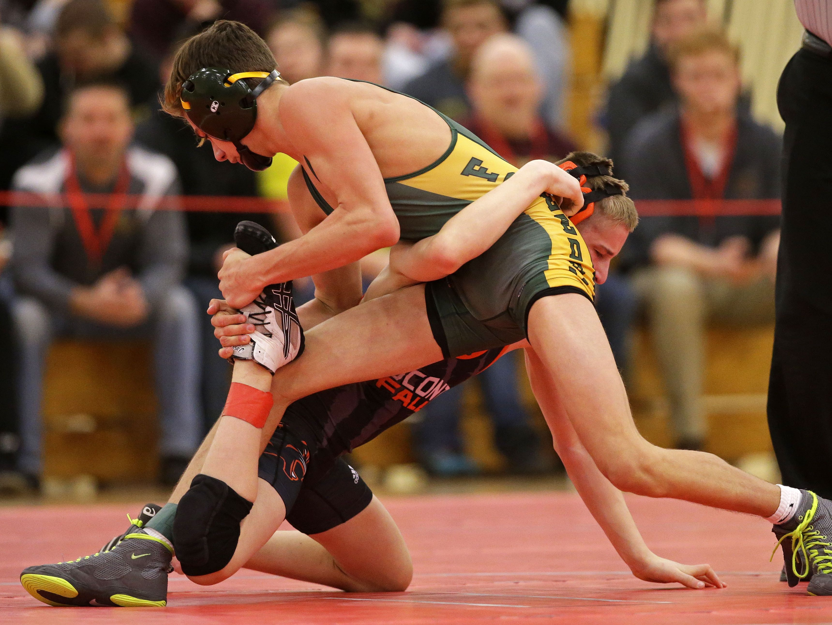 Tyler Budz of Oconto Falls wrestles Zach Lahay of Freedom in a 106 weight class 3rd place match during the WIAA Division 2 wrestling sectional Saturday, February 18, 2017, at Seymour High School in Seymour, Wisconsin. Ron Page/USA TODAY NETWORK-Wisconsin