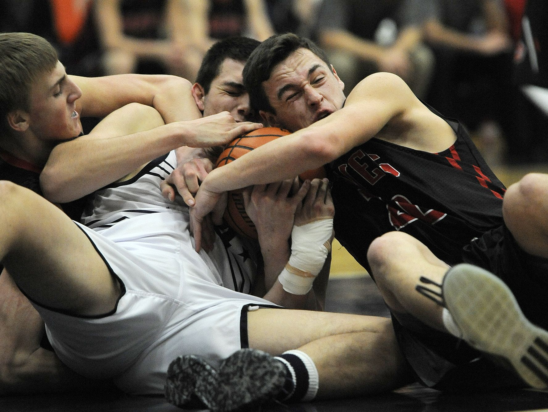 Providence's Alex Judd (center) is sandwiched by Brownstown Central as he battles for a loose ball on Saturday at Providence High School. (Photo by David Lee Hartlage, Special to The Courier-Journal) Feb.18, 2017