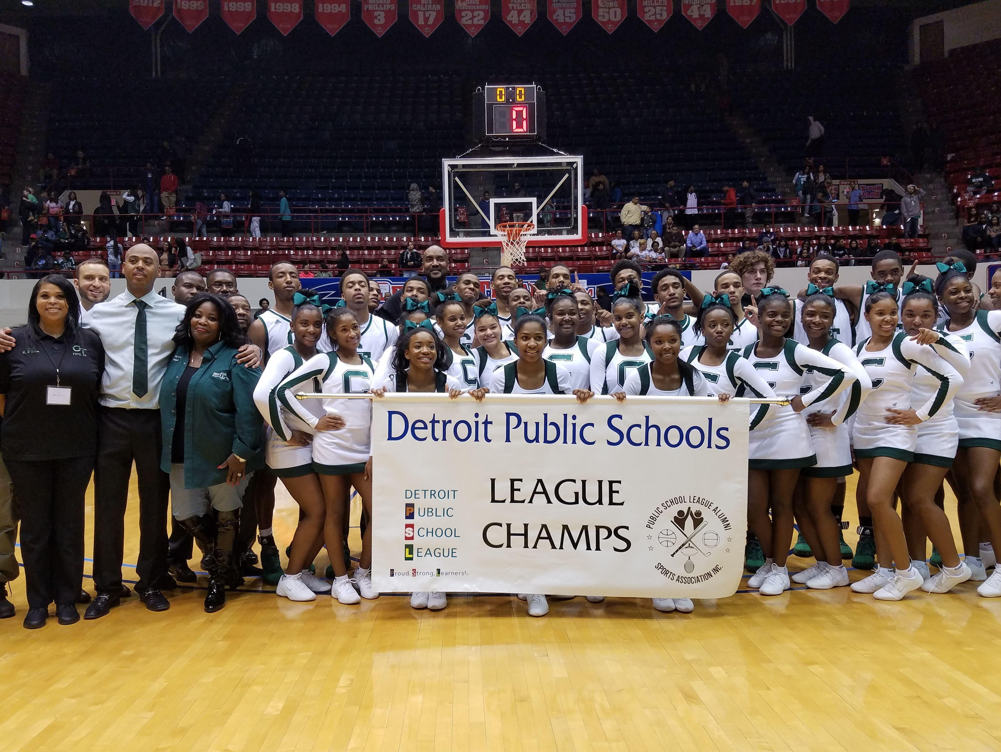 Members of Cass Tech's boys basketball team celebrate winning their first Detroit Public Schools League championship since 1998 on Saturday, Feb. 18, 2017, at Calihan Hall. The Technicians beat Detroit King, 59-47.