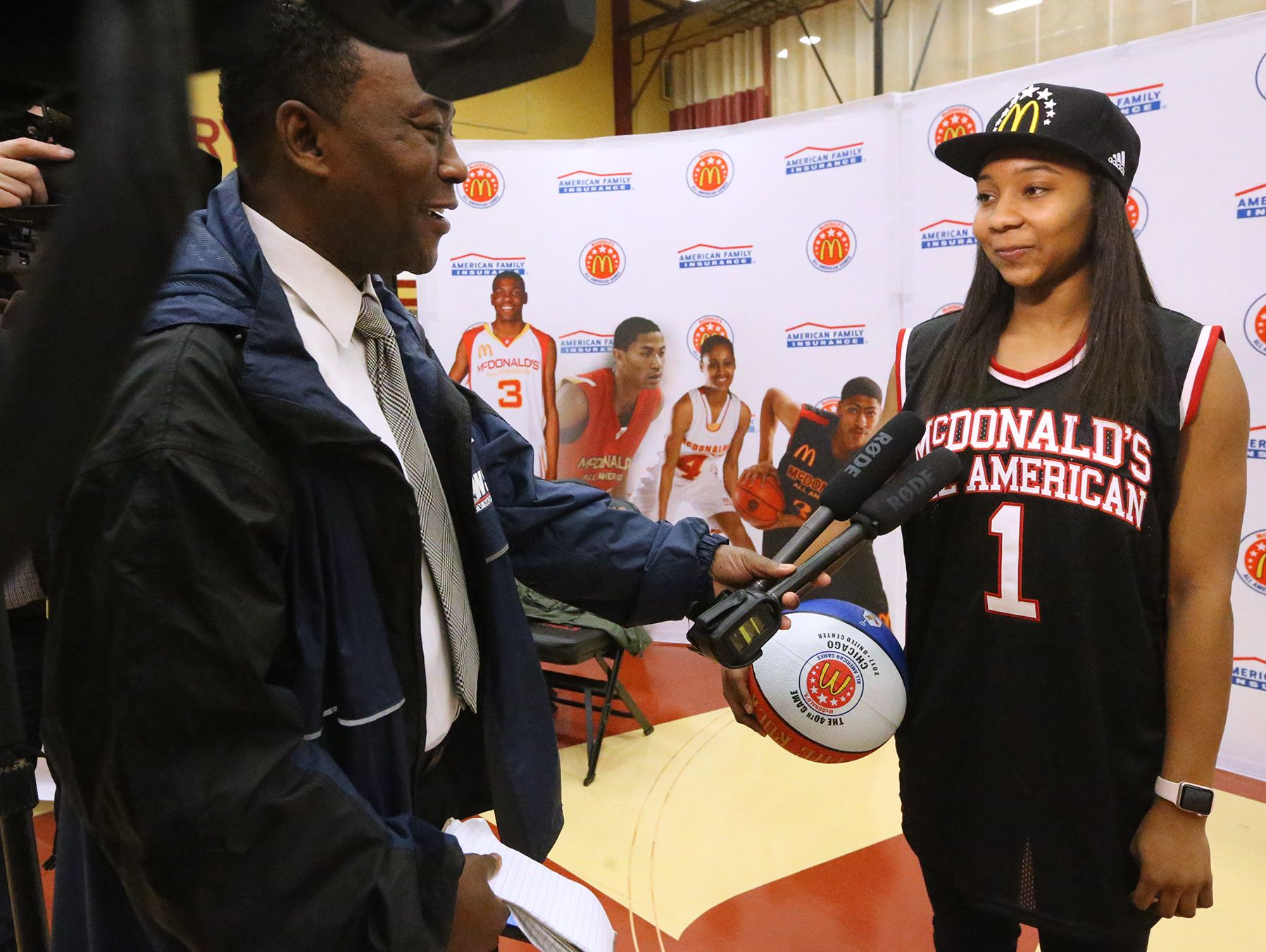 Riverdale's Anastasia Hayes talks with Larry Flowers other members of the media after being presented with her McDonald's All American jersey and hat on Tuesday, Feb. 21, 2017, at the school after being named as part of the 40th All American team.
