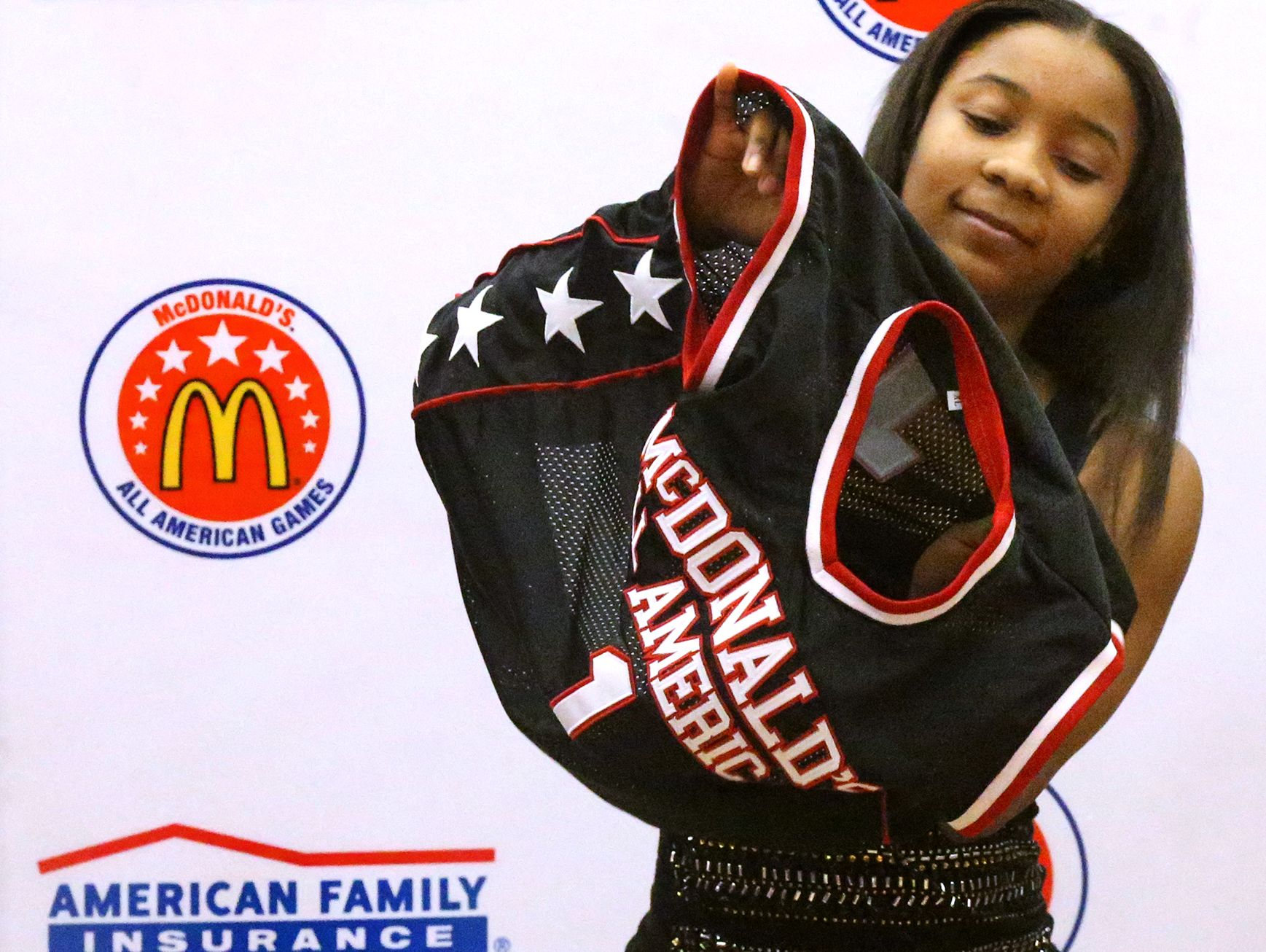 Riverdale's Anastasia Hayes was puts on her McDonald's All American jersey on Tuesday, Feb. 21, 2017, at the school after being named as part of the 40th All American team. (Photo: Tennessean)