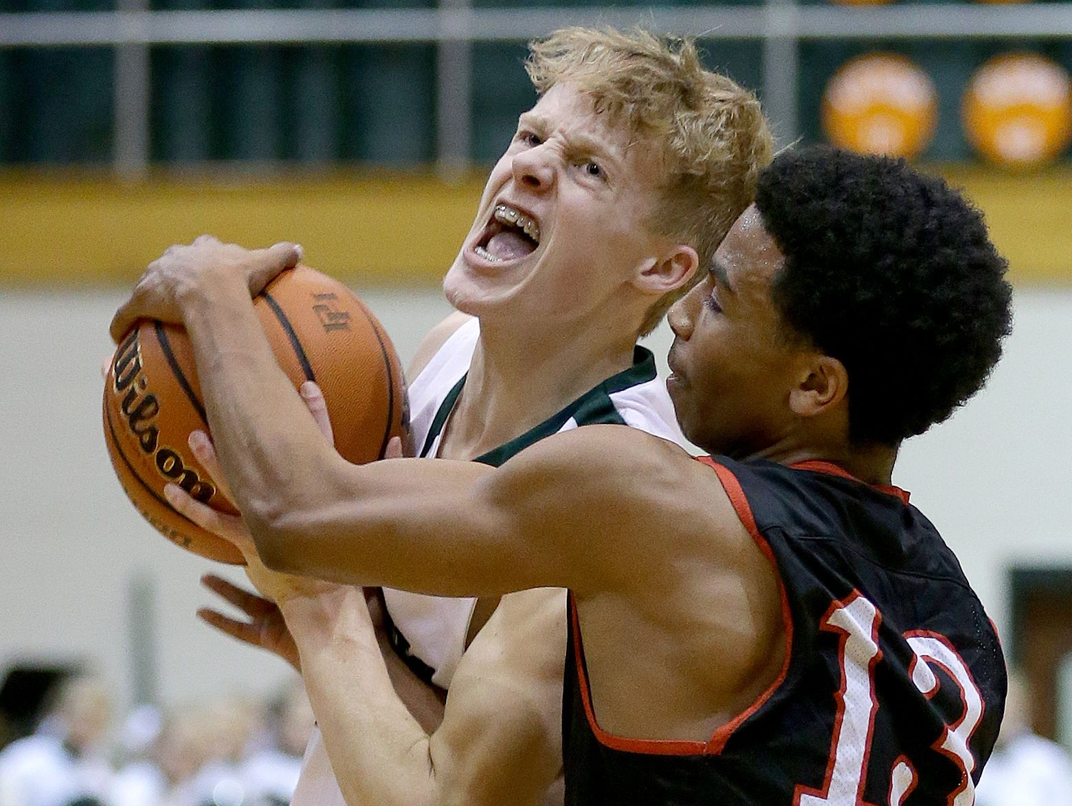 Pendleton Heights Arabians Karsten Windlan (10) is fouled by North Central Panthers Caleb Pack (13) in the first half of their game Tuesday, February 21, 2017, evening at Pendleton Heights High School.