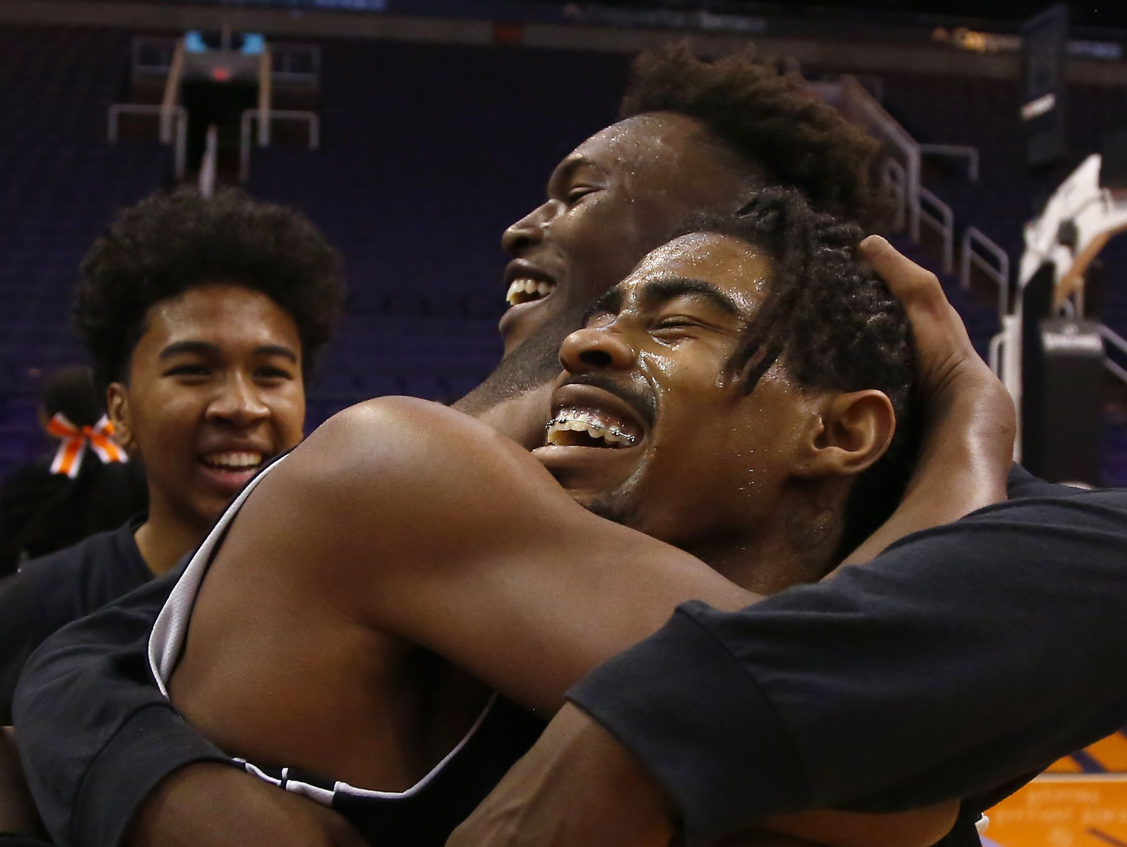 Skyline celebrates its win in the Division III Canyon Athletic Association Championship over Tri-City Christian, 69-65, at Talking Stick Resort Arena on February 24, 2017 in Phoenix, Ariz.