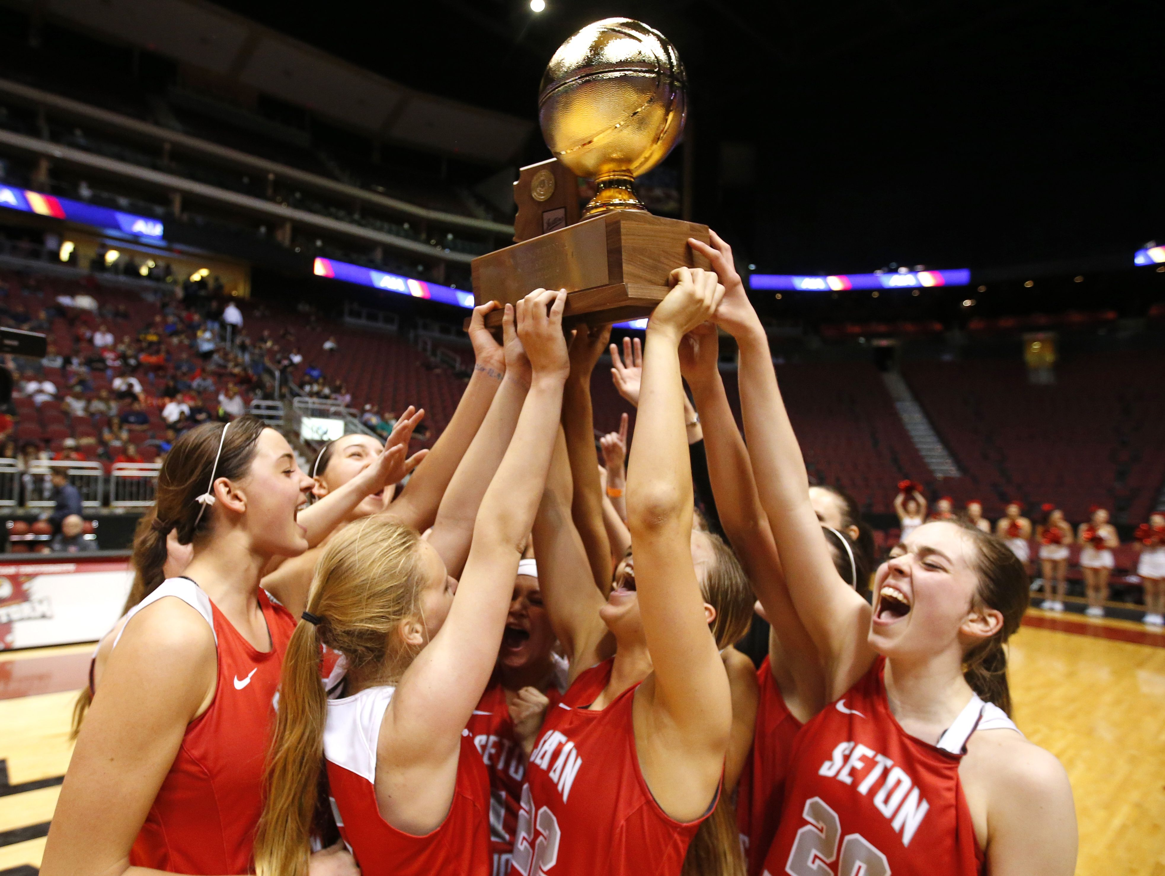 Seton Catholic celebrates after winning high school girls basketball: 4A Conference state championship game against the Cactus Shadow at Gila River Arena in Glendale on February 25, 2017.