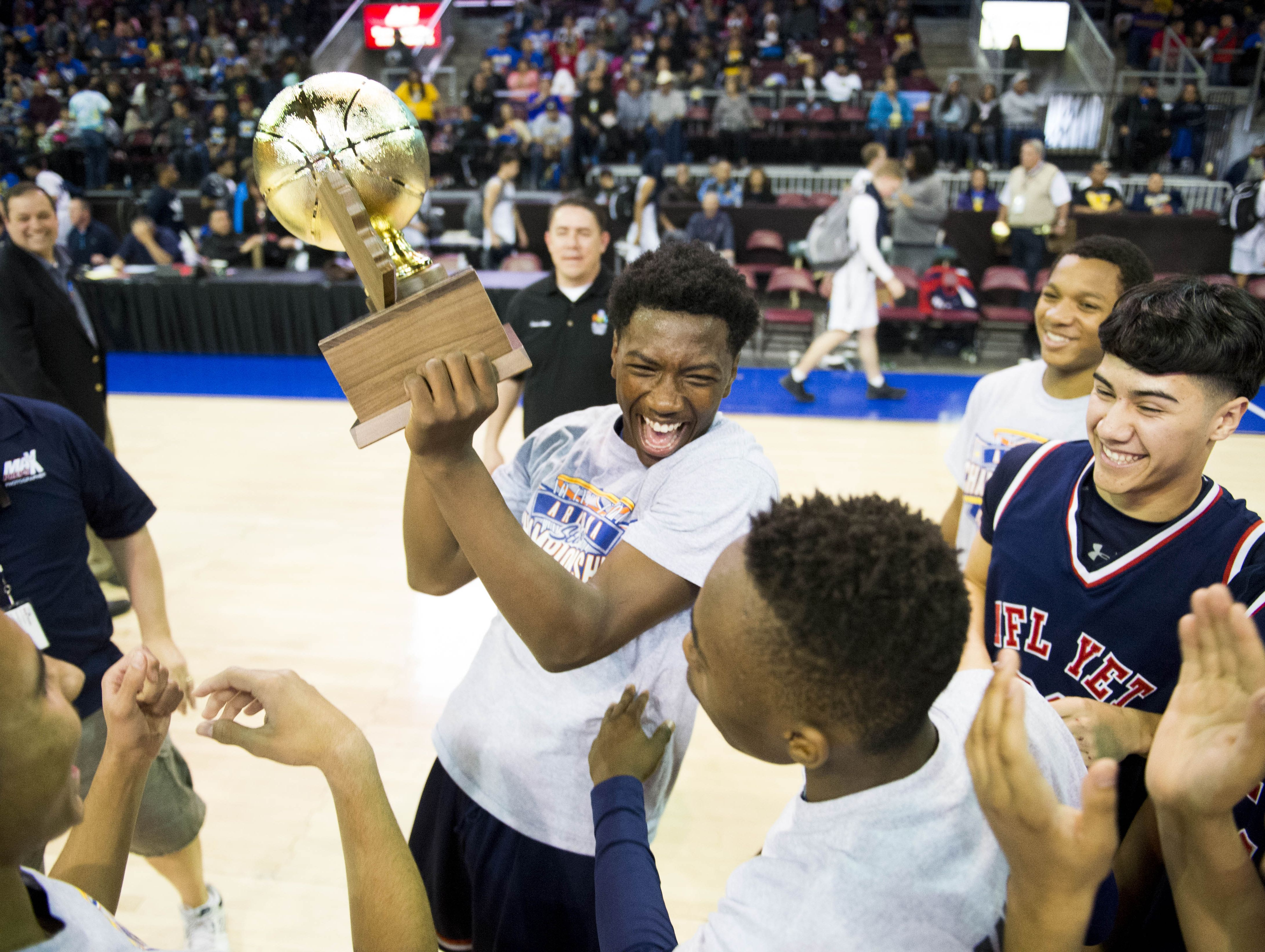 NFL YET's basketball team celebrates on the court after winning the 1A boys state championship game at the Prescott Valley Event Center in Prescott Valley on Saturday, Feb. 25, 2017.