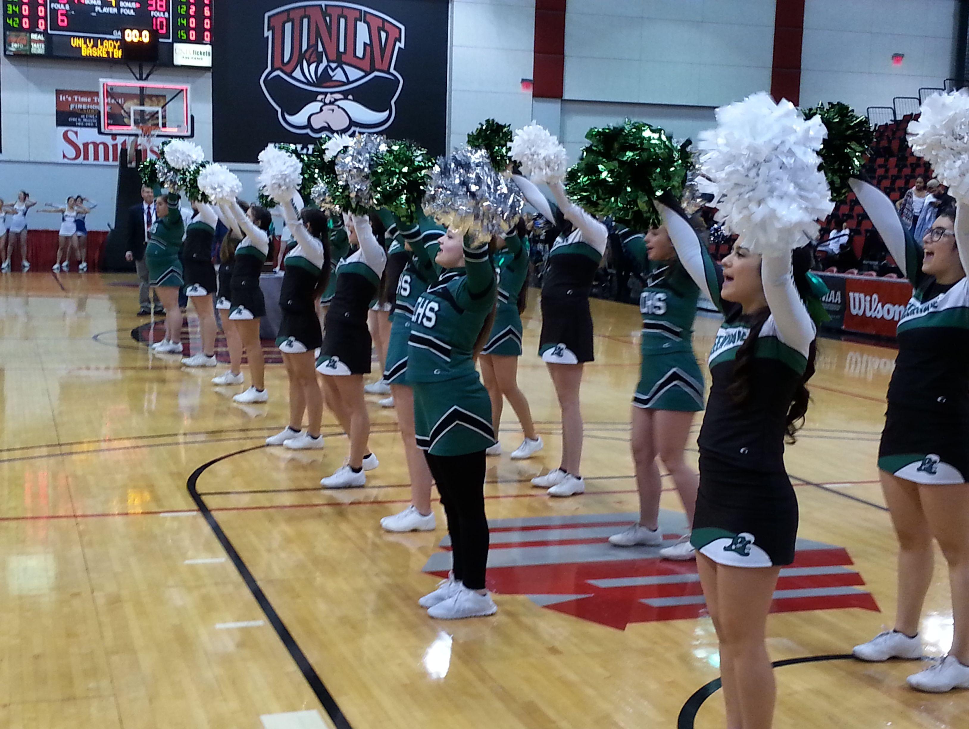 The Fallon cheerleaders celebrate the Greenwave's state championship Saturday in Las Vegas.