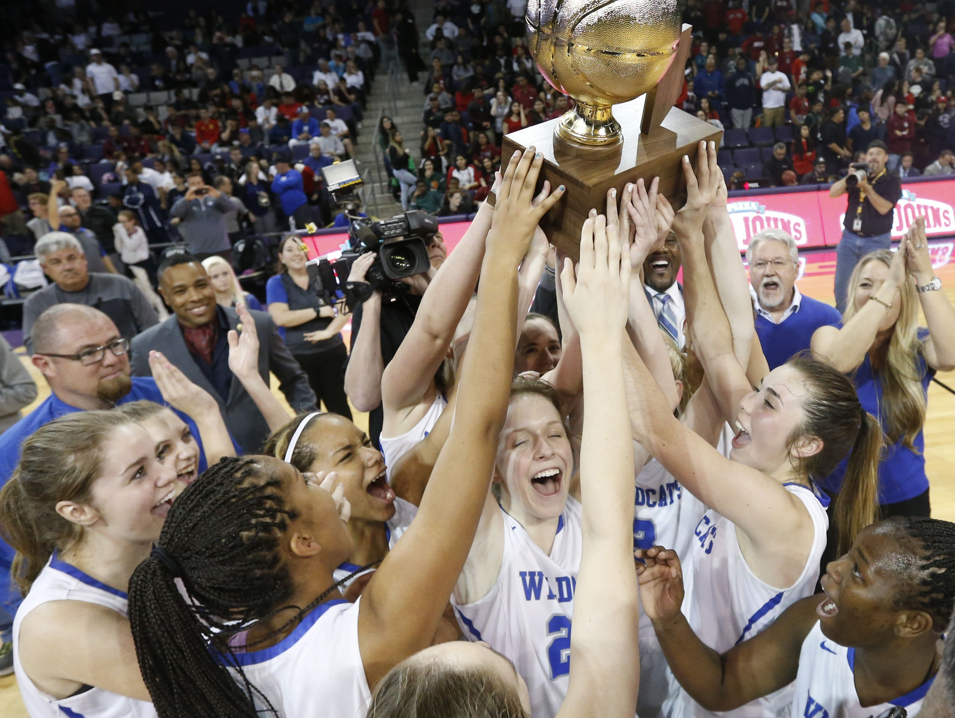 Mesquite lifts the championship trophy after beating Sierra Linda during the State Championship game at GCU Arena on February 27, 2017 in Phoenix, Ariz.