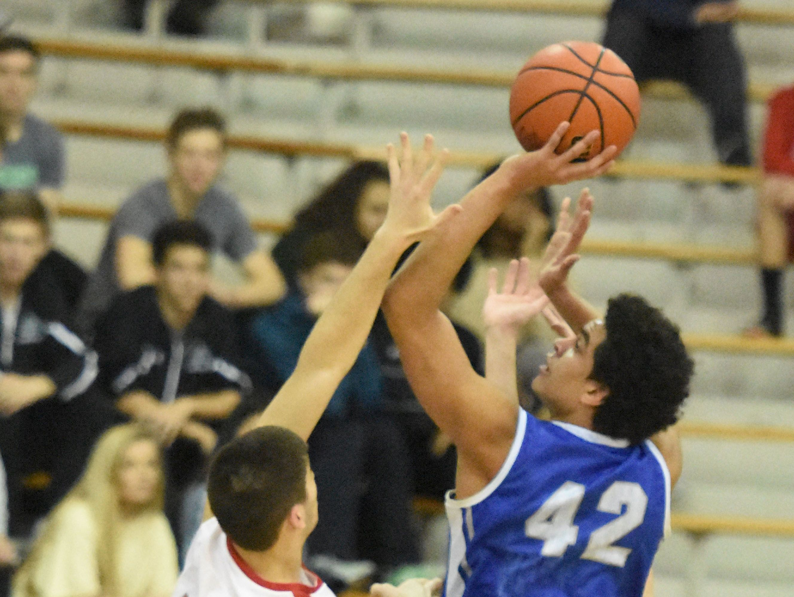 Hamilton Southeastern's Zach Gunn (42) once again paced the Royals past Fishers on Tuesday night.