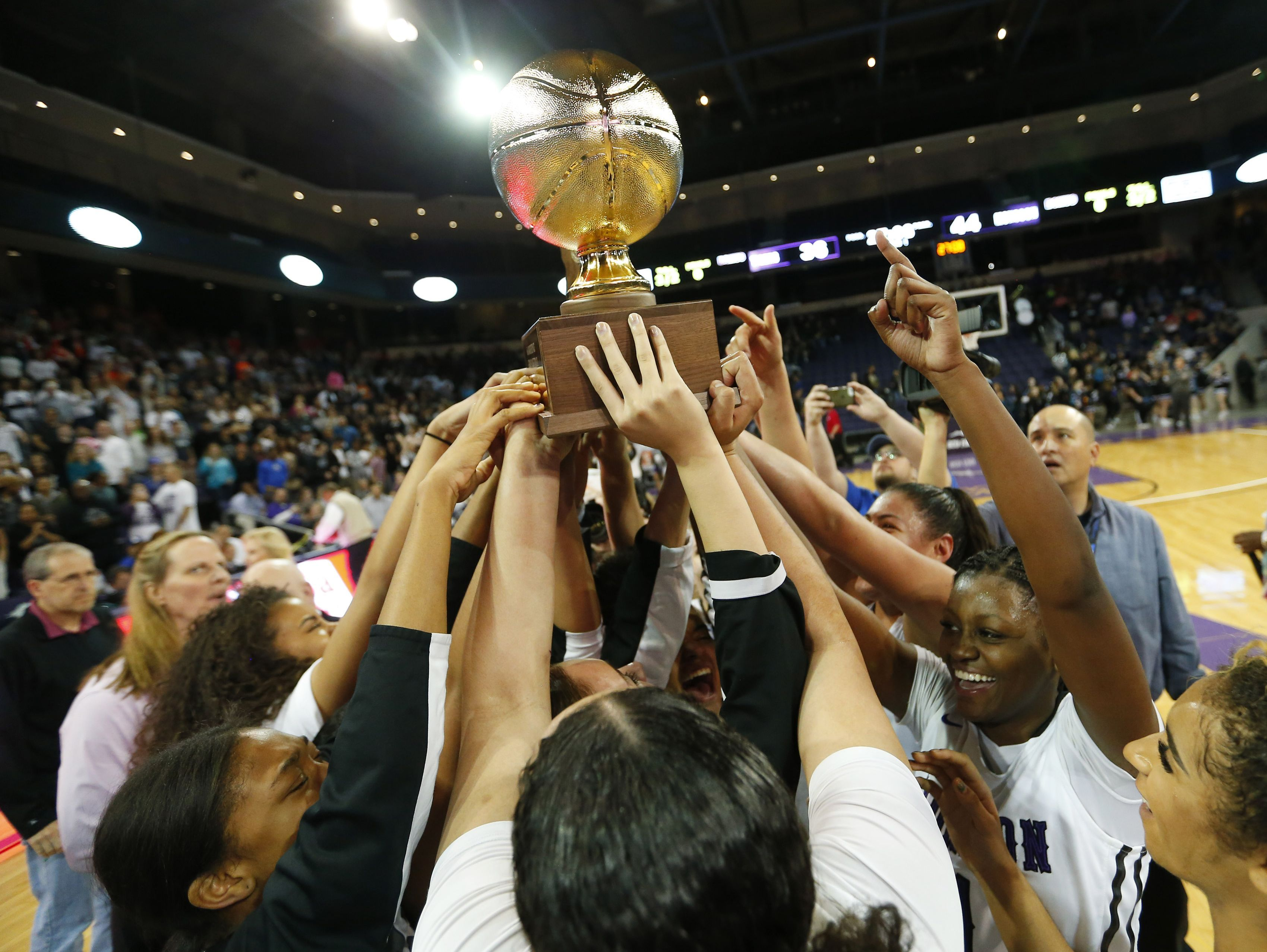 Valley Vista players celebrate their 44-36 victory against Millennium during the finals of the 6A Conference state championship at GCU Arena in Phoenix, Ariz. February 28, 2017.