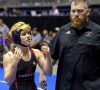 Mack Beggs, left, a transgender wrestler from Euless Trinity High School, stands with his coach Travis Clark. (Photo: AP)