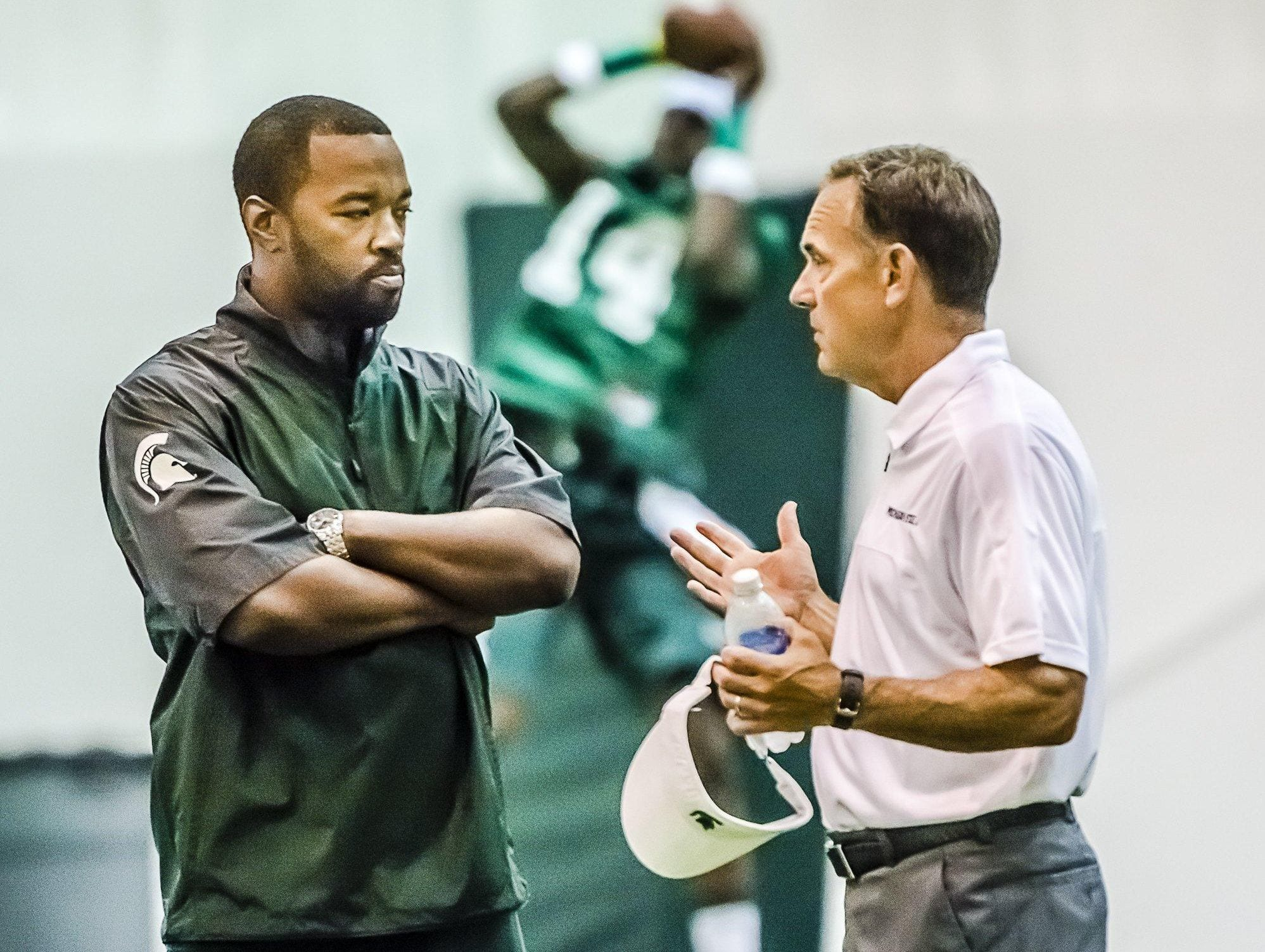 Curtis Blackwell, left, coordinates recruiting for MSU coach Mark Dantonio. The process has changed since Blackwell went through it.