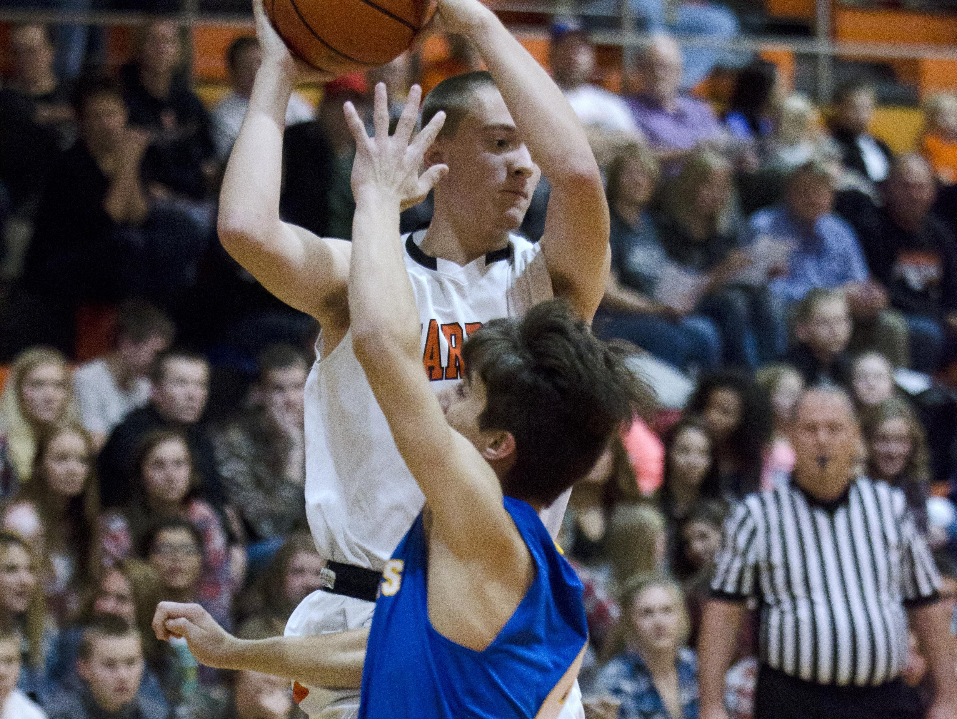 Carson Rentz of Dell Rapids passes the ball Friday, Dec. 9, against West Central in the Quarriers' season opener at Dell Rapids.