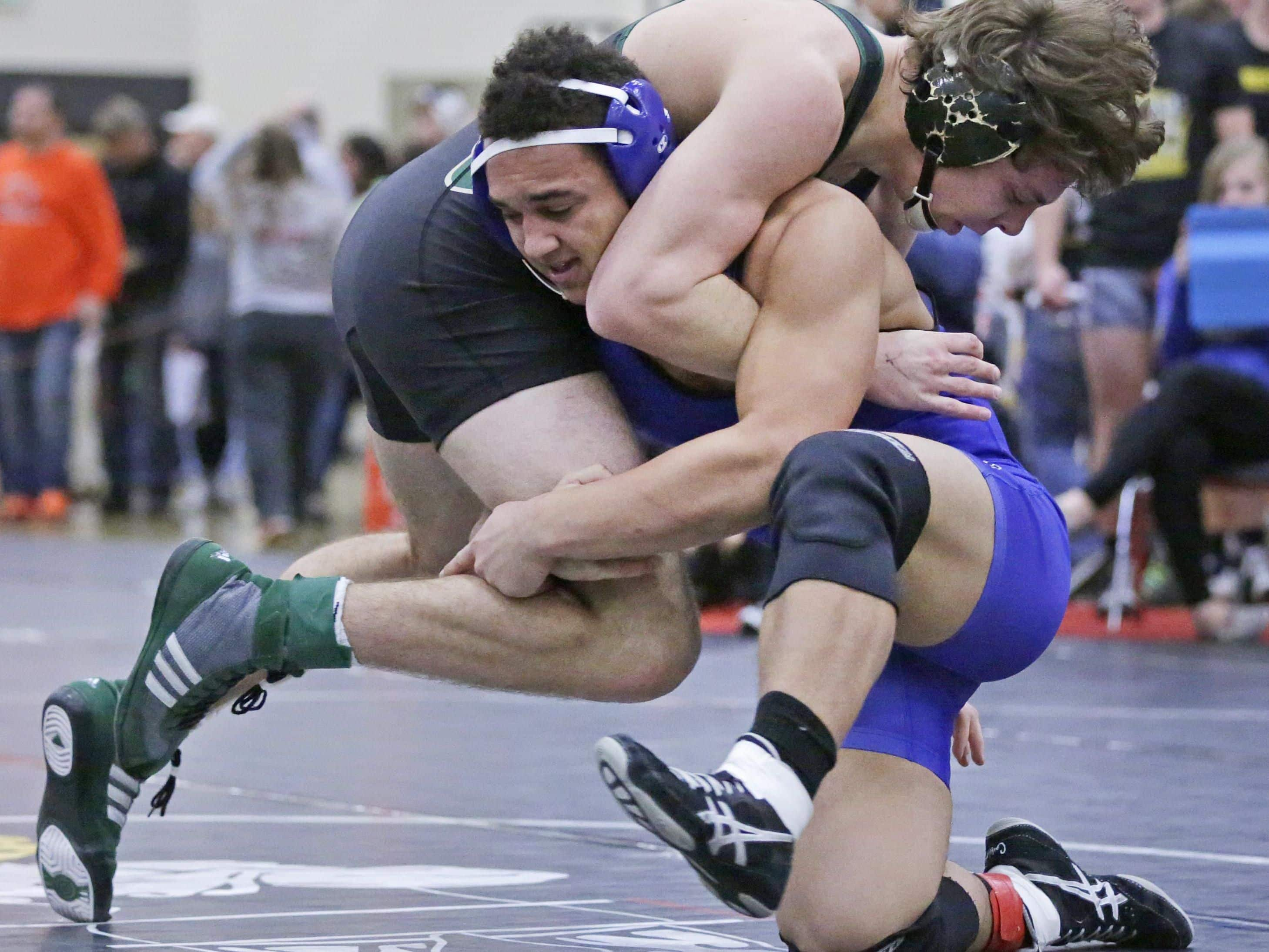 Wrightstown's Bryce Herlache, bottom, is one of four wrestlers at the WIAA Division 2 Denmark regional ranked No. 1 in their weight class by WIWrestling.com.