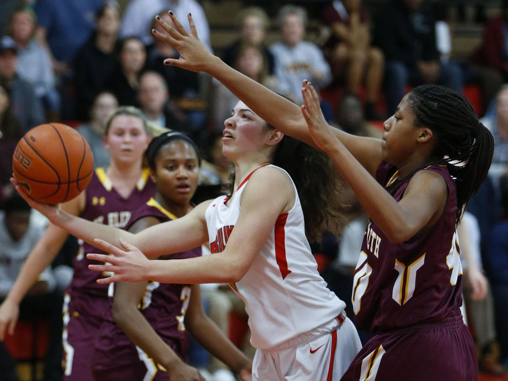 Ursuline's Alisha Lewis (left) goes to the basket in front of St. Elizabeth's Alexis Lee in the second half of Ursuline's 58-43 home win Wednesday.