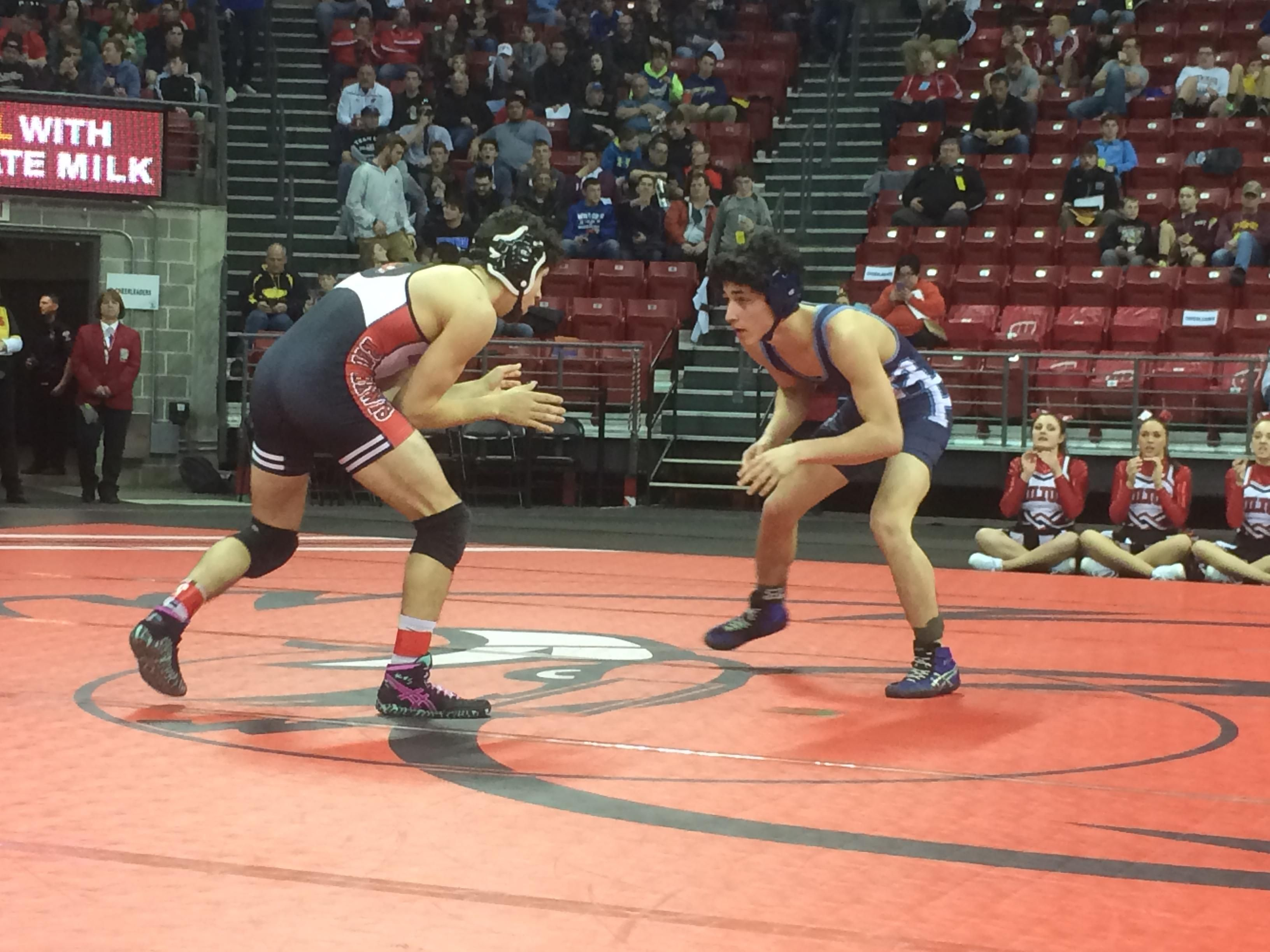 Bay Port senior Brady Shulfer won a 6-1 decision over Milton junior Vince Digennaro in a 145-pound Division 1 preliminary match on Thursday during the WIAA individual state wrestling tournament at the Kohl Center.