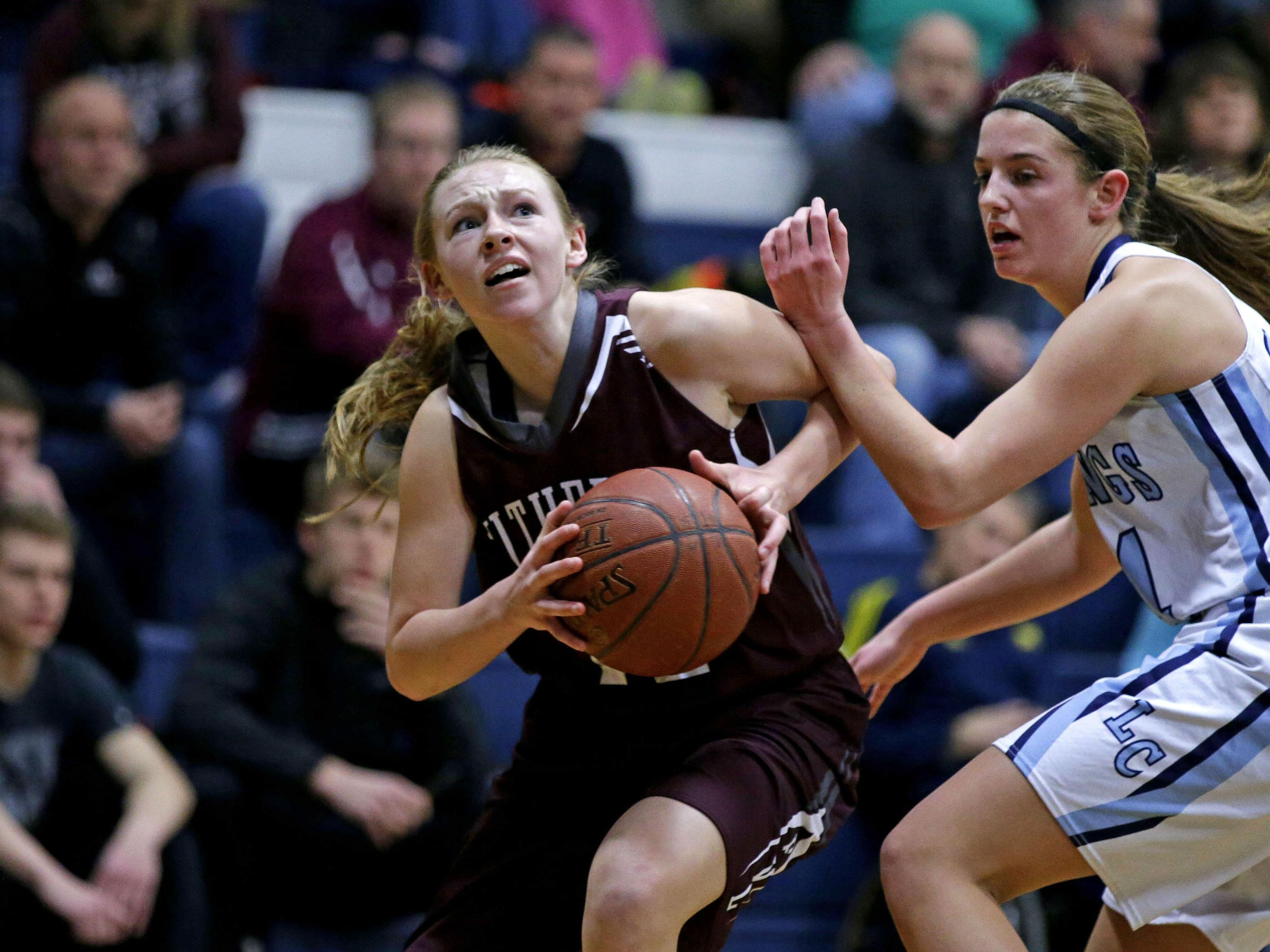 Jenna Bruss, left, of Fox Valley Lutheran drives against Olivia Hermsen of Little Chute during a WIAA Division 3 regional semifinal Friday in Little Chute.