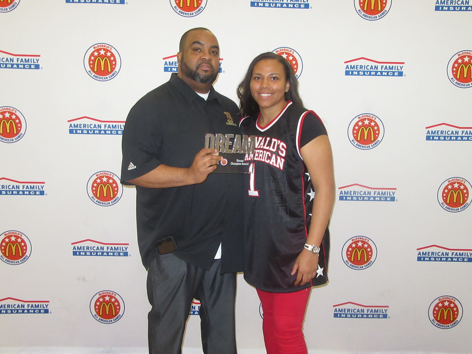 Destiny presented her coach and guardian, Marlon Wells, with the Dream Champion Award. (Photo: McDAAG)
