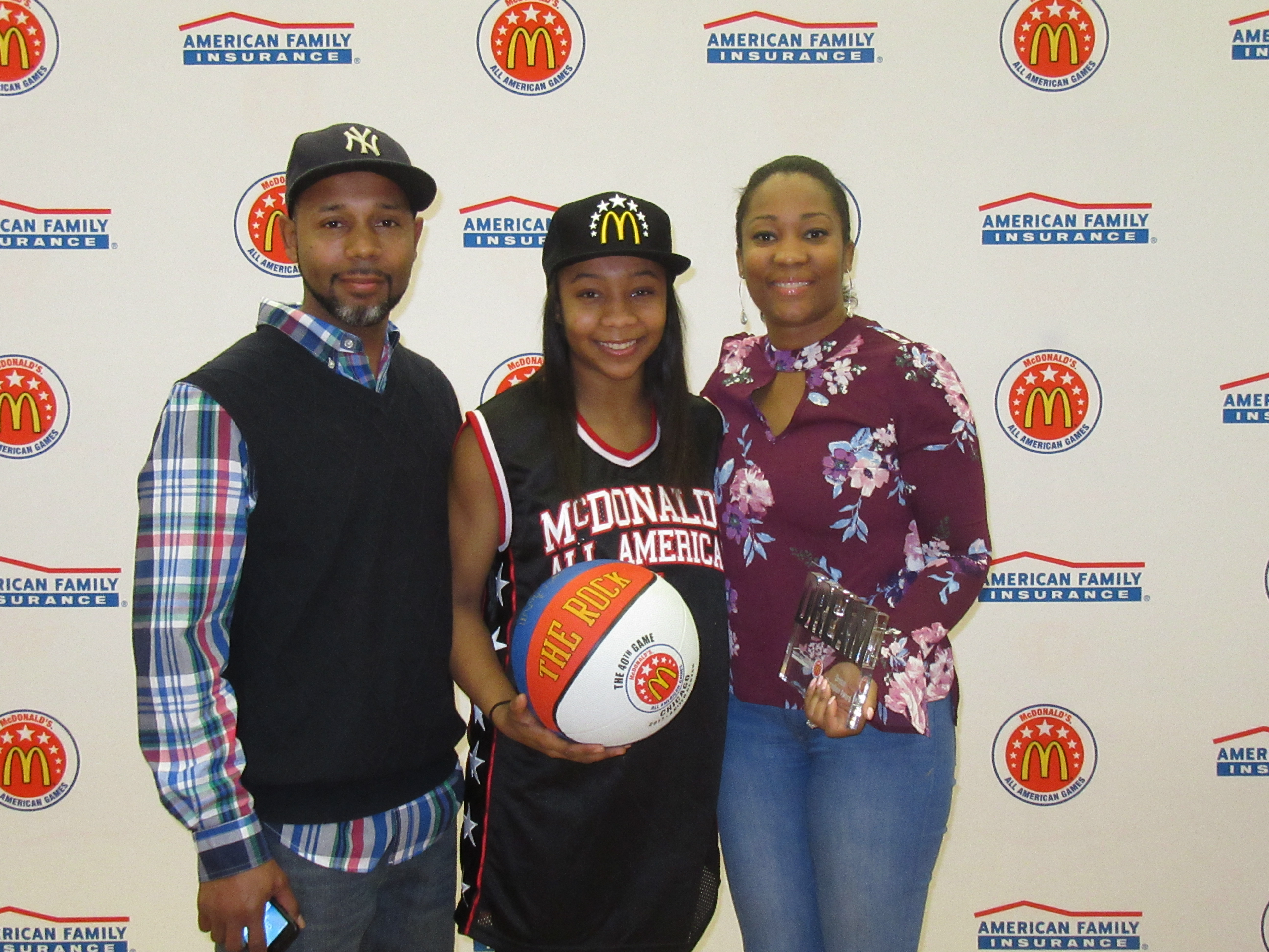 Anastasia Hayes presented her parents, Arnett and Sherry Hayes, with the Dream Champion Award. (Photo: McDAAG)