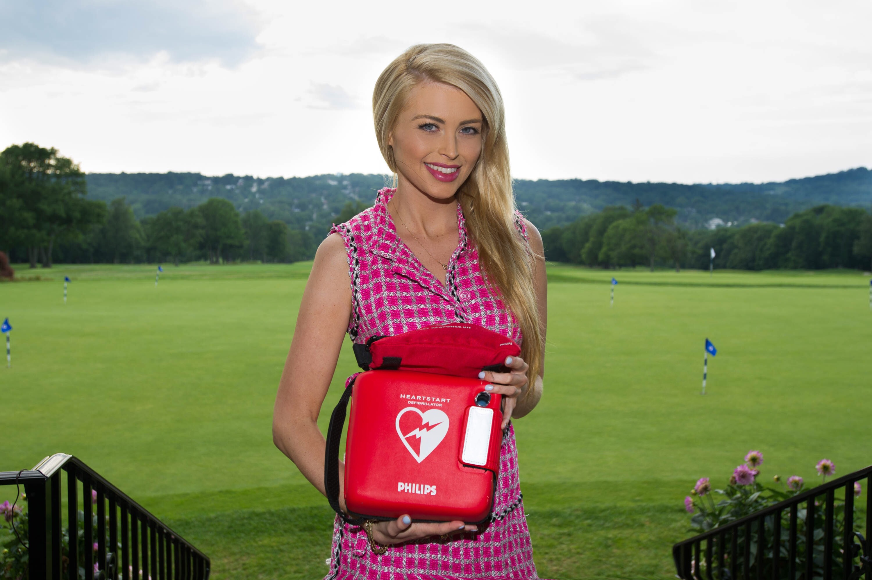 Former Miss Ohio Lindsay Davis holding an AED.