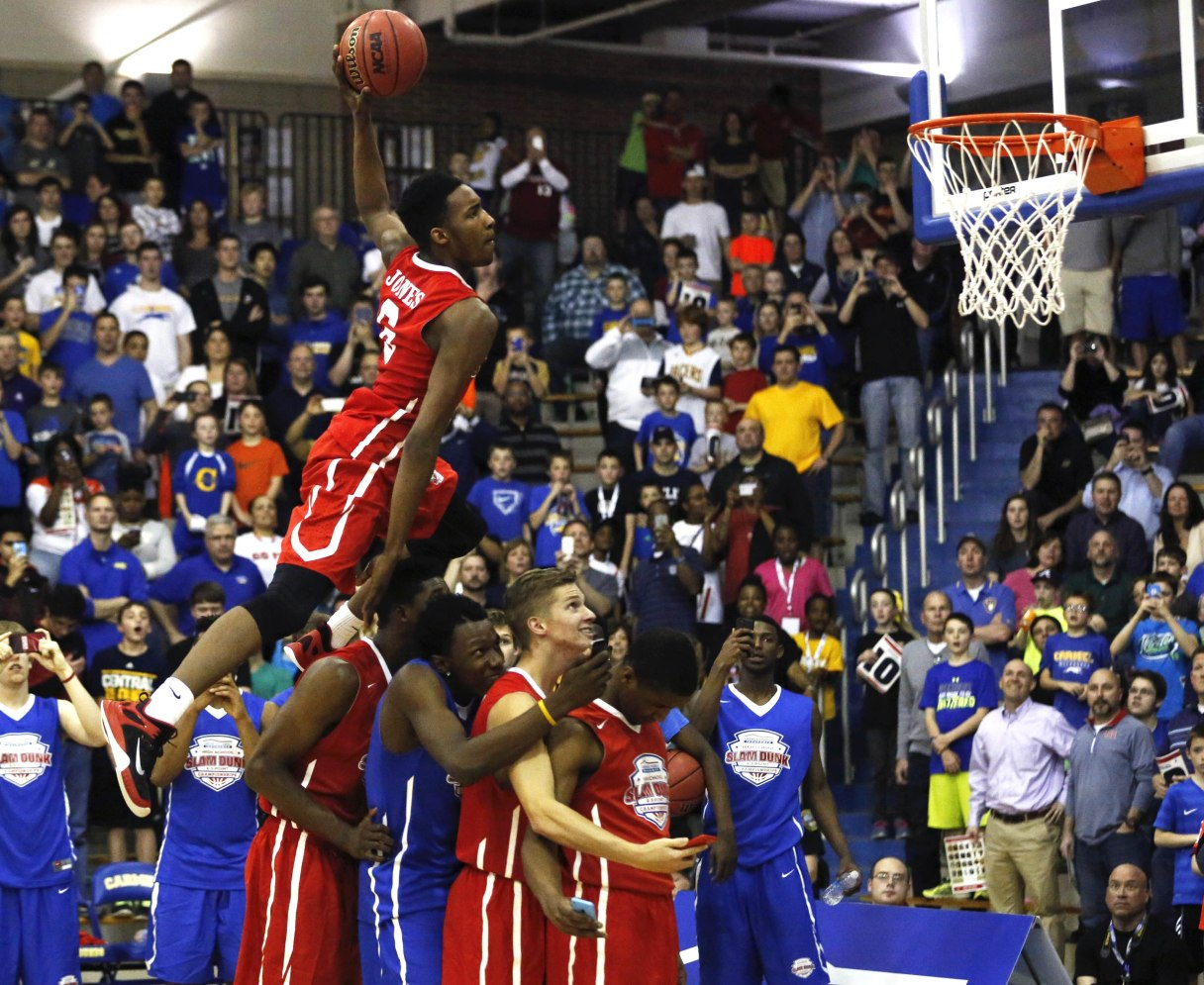 Apr 1, 2015; -- Carmel, IN, U.S.A -- American Family Insurance Slam Dunk contestant Derrick Jones (6) dunks over teammates at the American Family Insurance High School Slam Dunk and Three-Point Championship -- Photo by Aaron Doster-USA TODAY Sports Images, Gannett ORG XMIT: US 132898 AM FAM Dunk 4/1/2015 [Via MerlinFTP Drop]