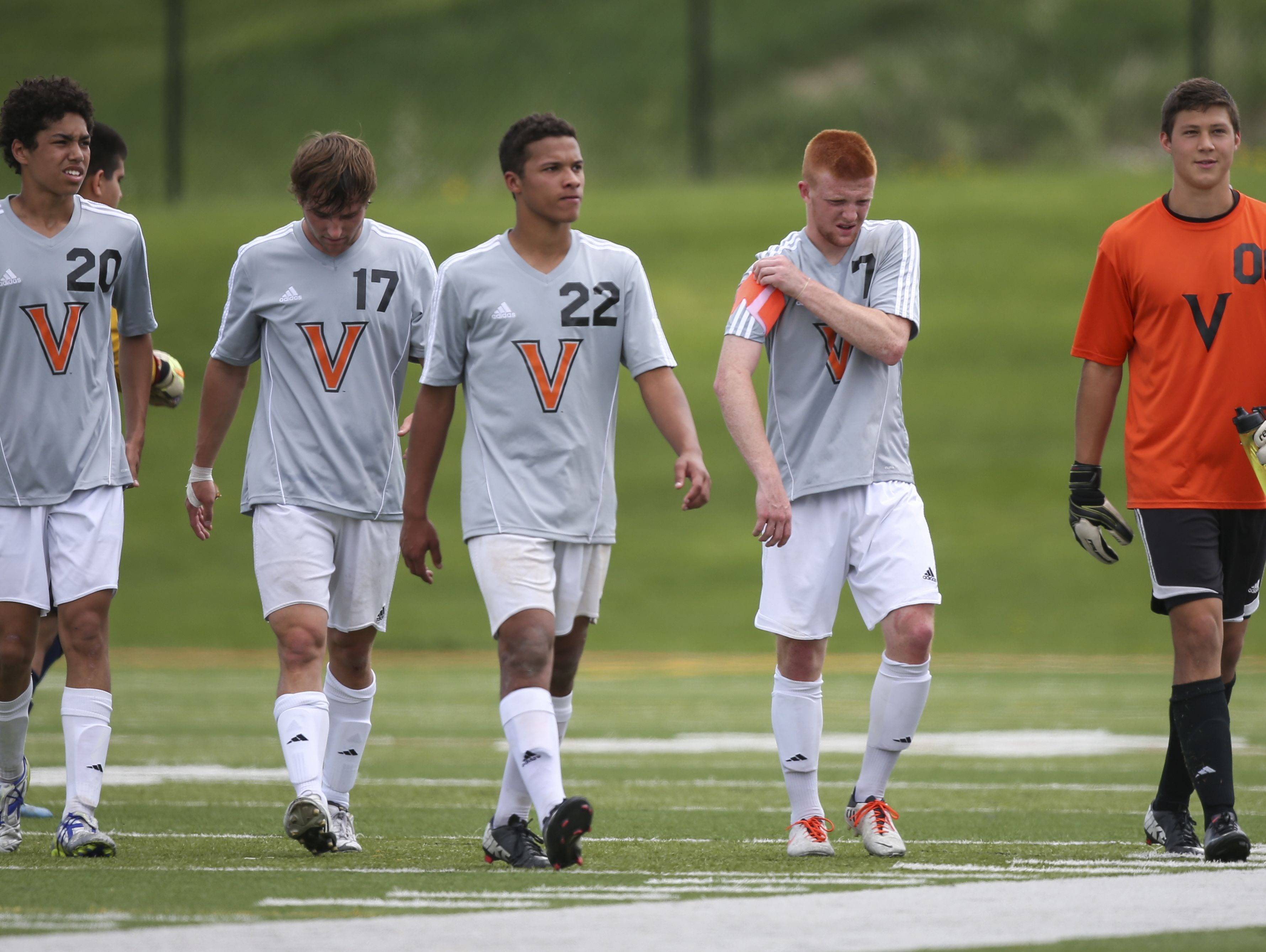 Valley soccer players Aaron Williams, 20, Britton Hiskey, 17, Addison Parrish, 22, Jordan Lucas, 7, and AJ Thompson, 00, walk off the field together during a varsity boys soccer match between West Des Moines Valley and Sioux City West on Saturday, May 10, 2014, at Valley Stadium in West Des Moines, Iowa.