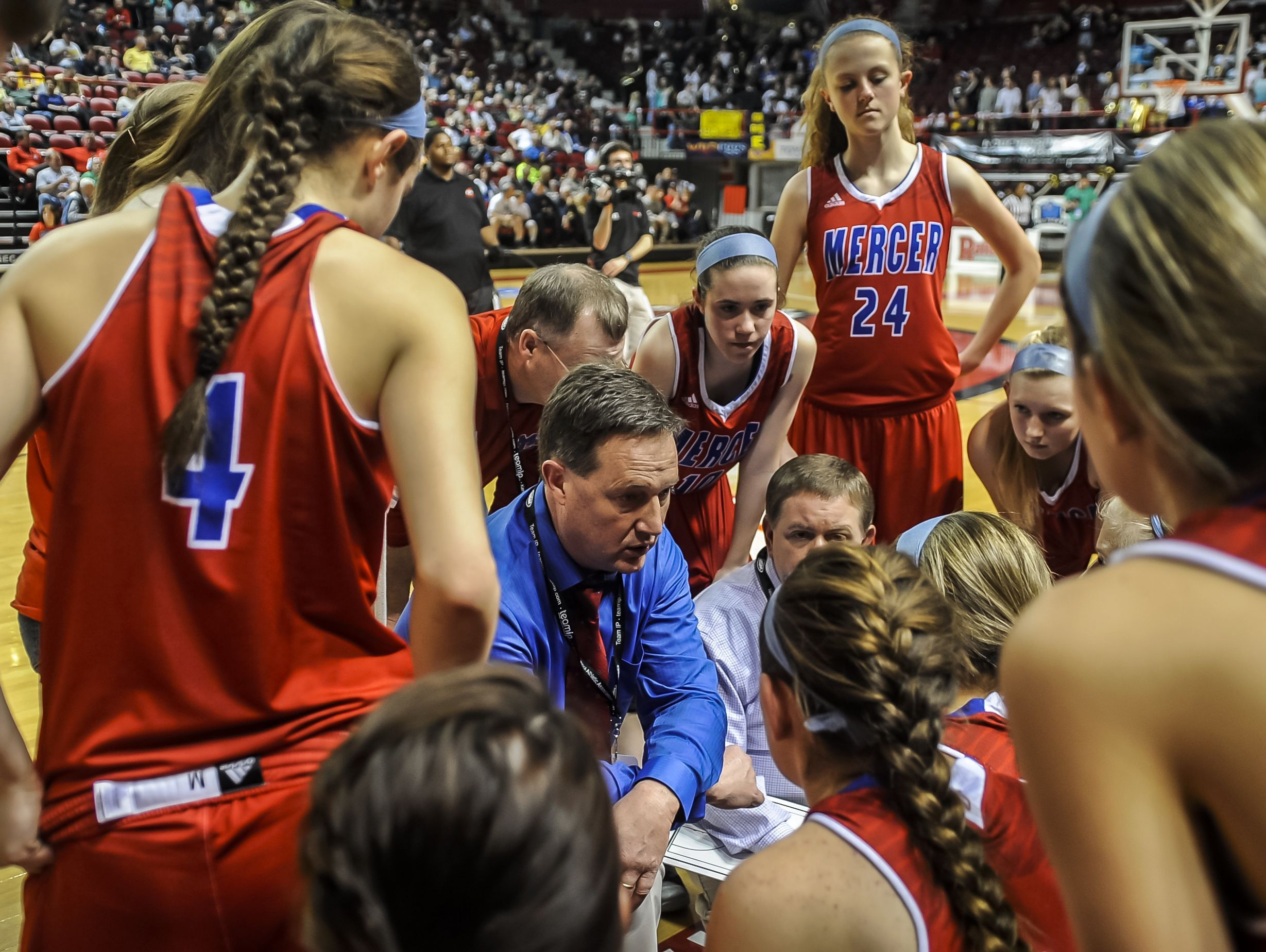 Mercer County's head coach Chris Souder, center, talks with players during a timeout in a KHSAA Girls' Sweet Sixteen high school basketball game against Elizabethtown, Wednesday, March 11, 2015, at E.A. Diddle Arena in Bowling Green, Ky. (AP Photo/Daily News, Bac To Trong)