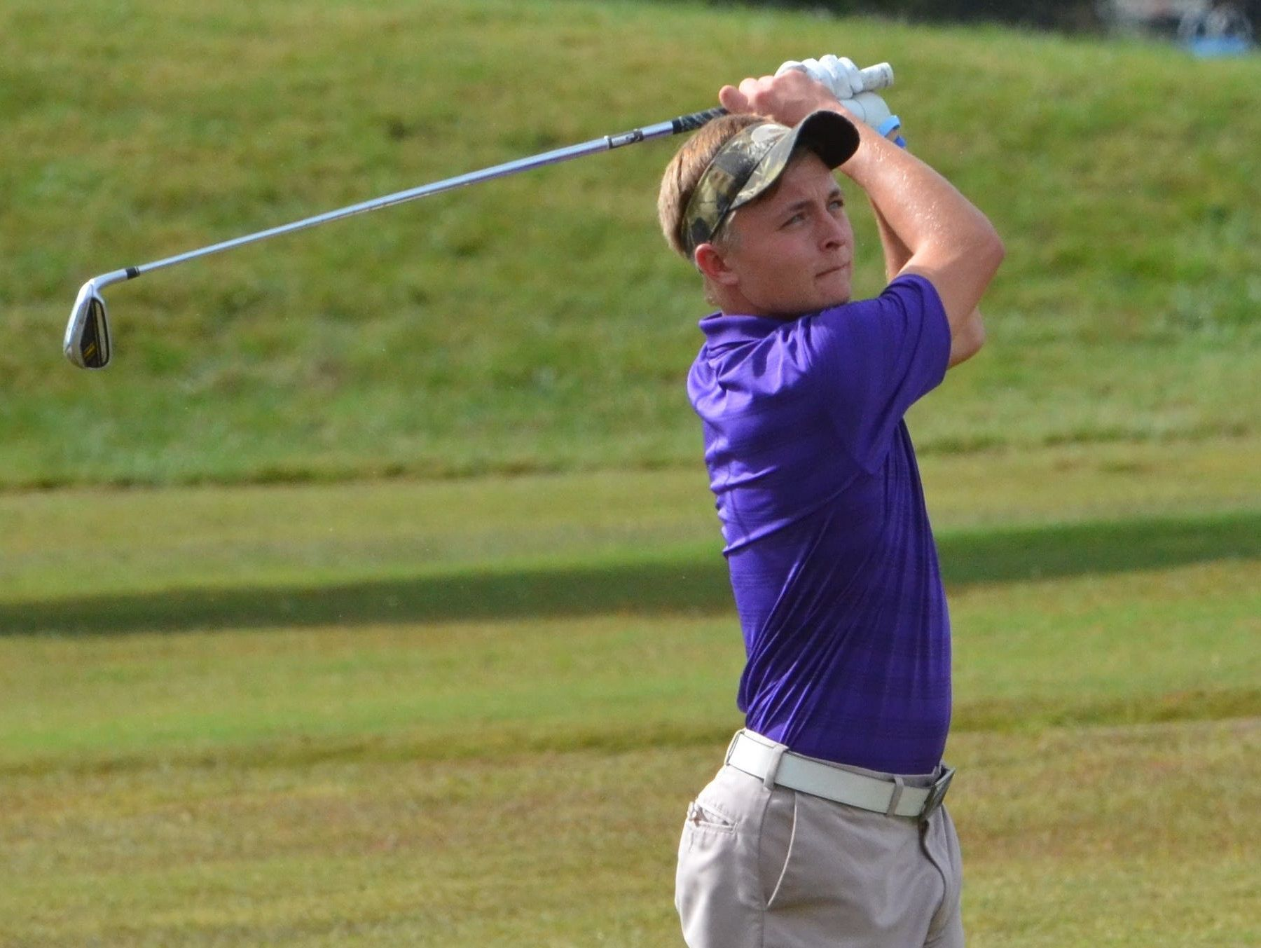 Clarksville High's Eric Jinnette drives a shot toward the green during the first round of the Class 3A State Golf Championships on Tuesday in Manchester, Tenn.