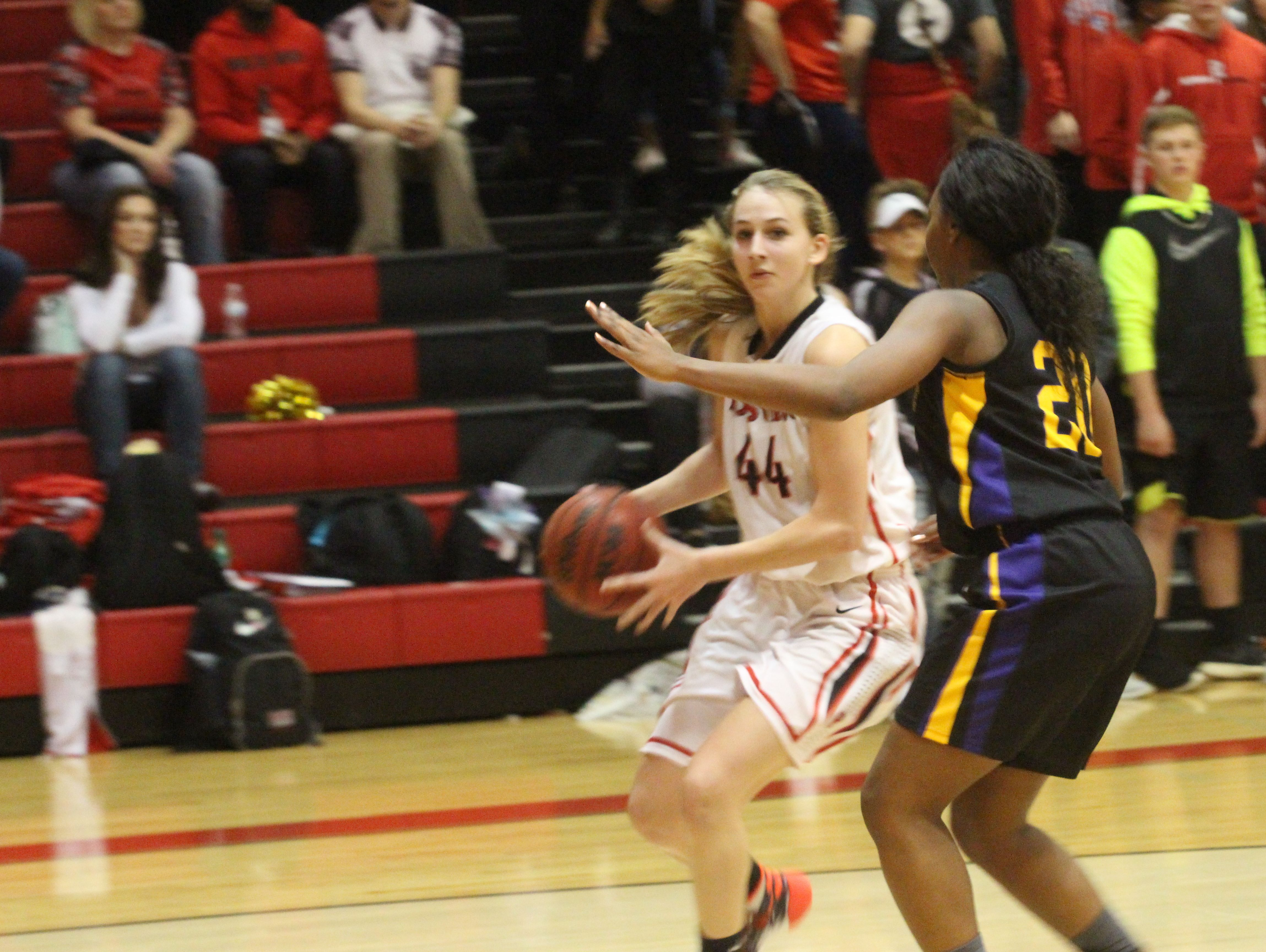 Rossview's Mickey Head (44) looks for room around Clarksville High's Prasha Fair (20) during the second quarter of their District 10 game Tuesday at Rossview High School.