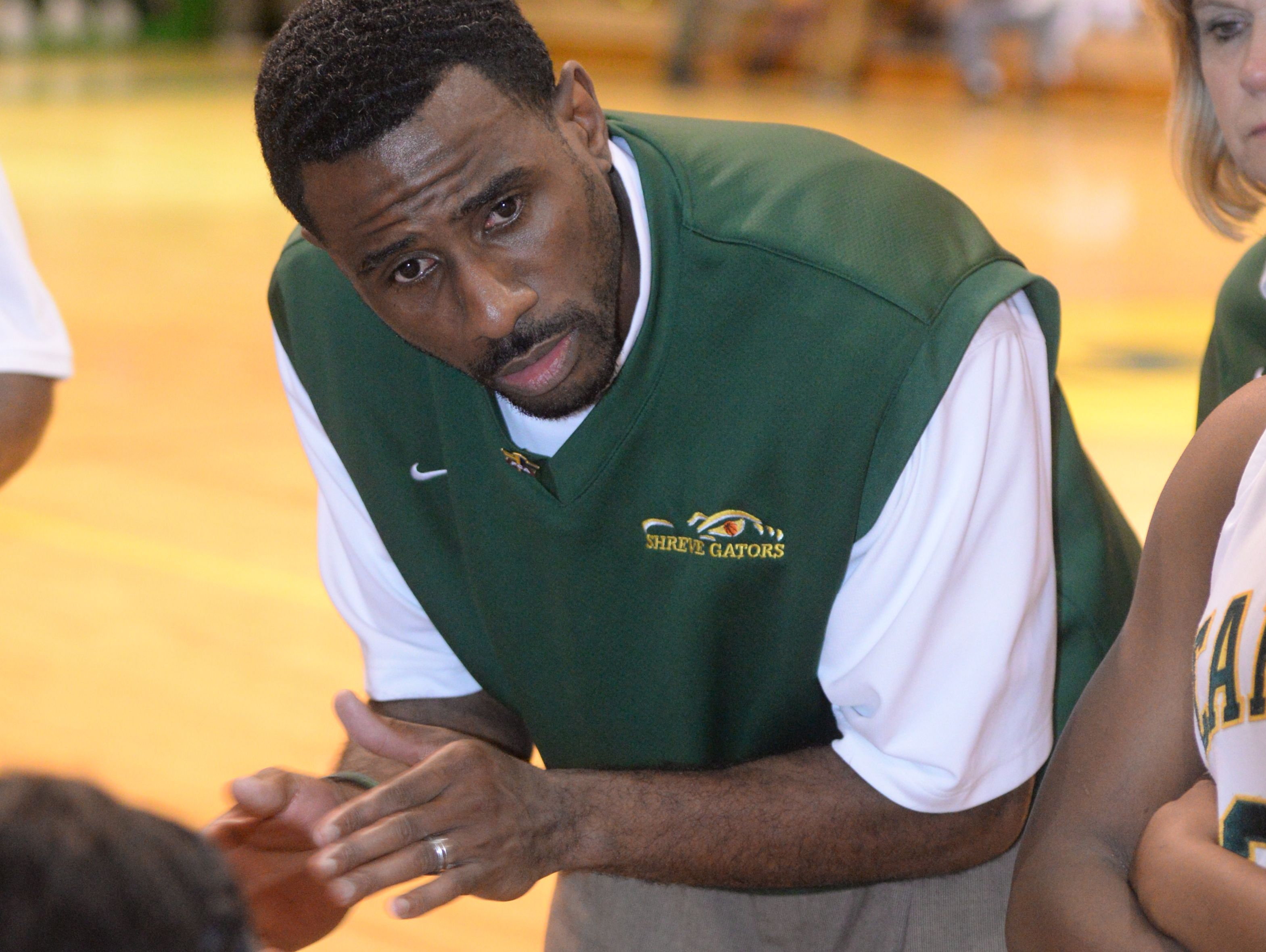 Capt. Shreve head coach Keith Greene talks to his team during a time out against Haughton.