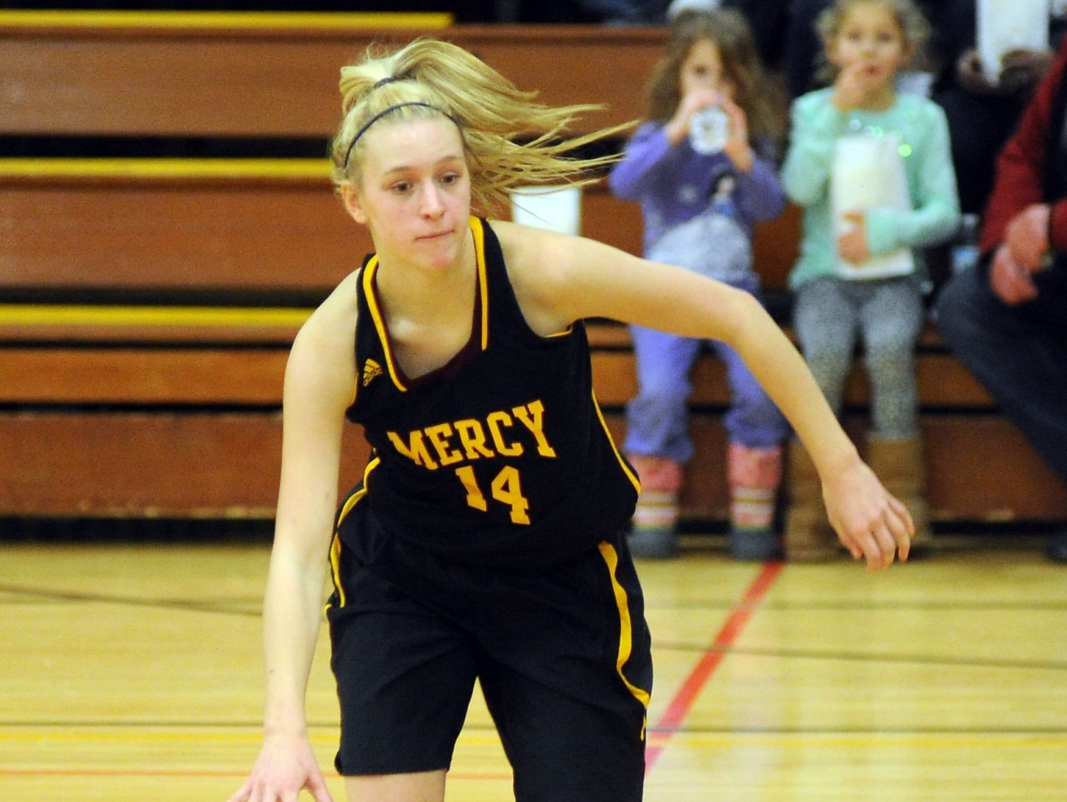 Sophomore point guard Jenna Schluter works against the West Bloomfield defense during a game last season.