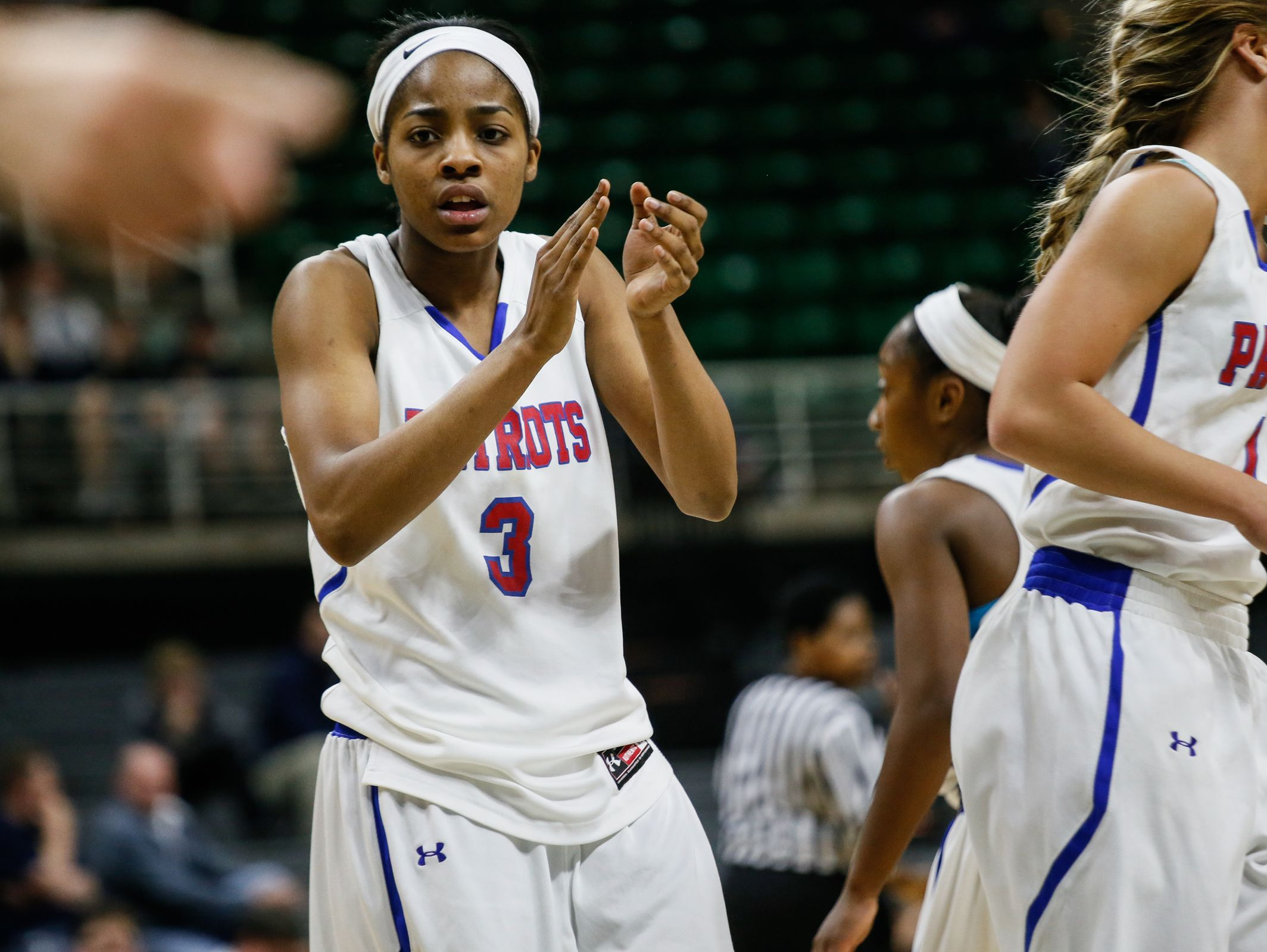 Warren Cousino's Kierra Fletcher claps her hands together after a fould was called during the MHSAA girls basketball Class A game 2 semifinals against Hudsonville at the Breslin Center in East Lansing, Mich. on Friday, March 18, 2016.