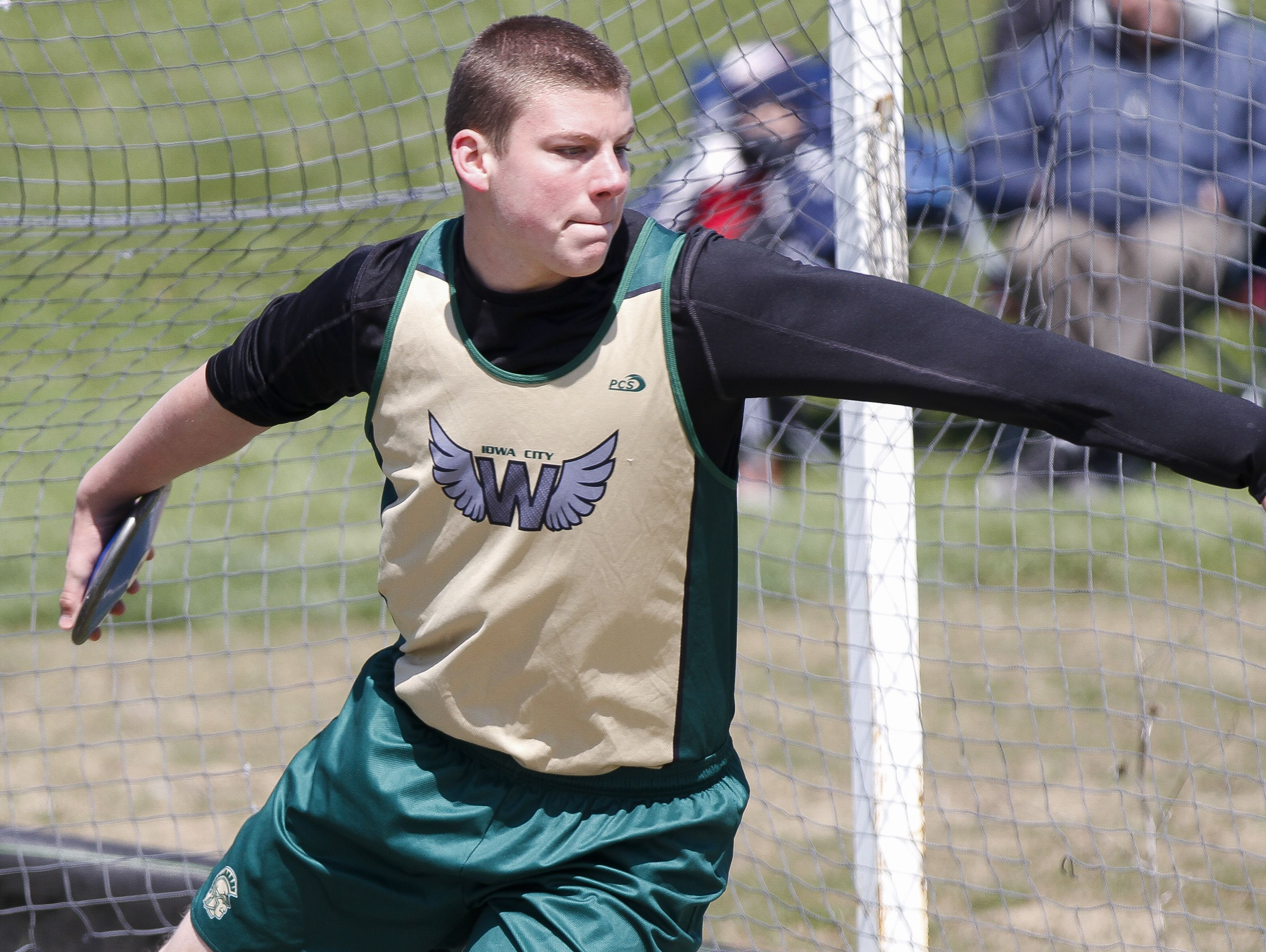 Iowa City West's Jonathan Gannon competes in the discus throw during the Hollingsworth Relays at Iowa City West on Saturday, April 9, 2016. (Tork Mason/Freelance)