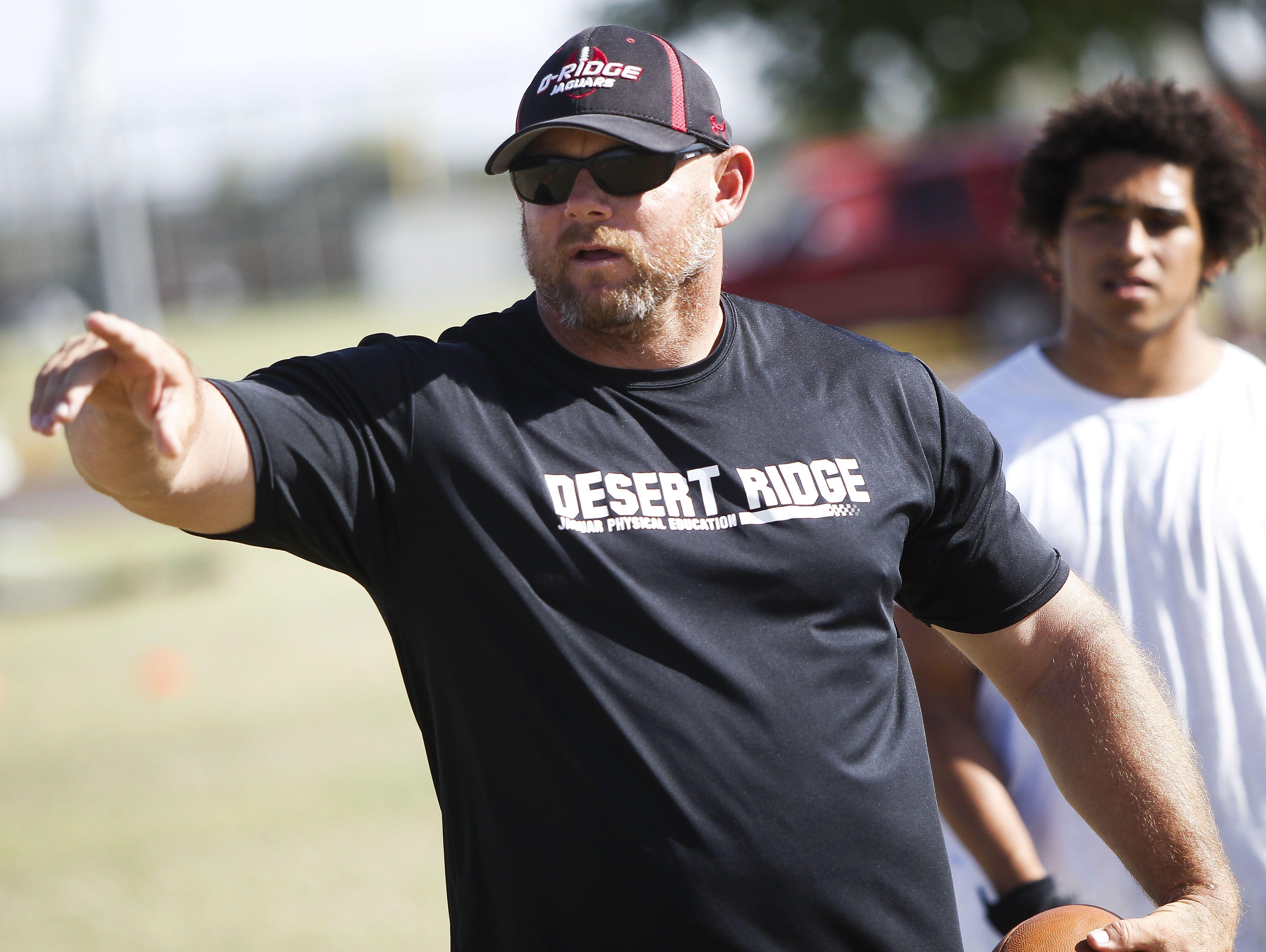 Head coach Jeremy Hathcock leads practice as the Desert Ridge Football team practices on Wednesday, April 27, 2016, at Desert Ridge High School in Mesa, Ariz.