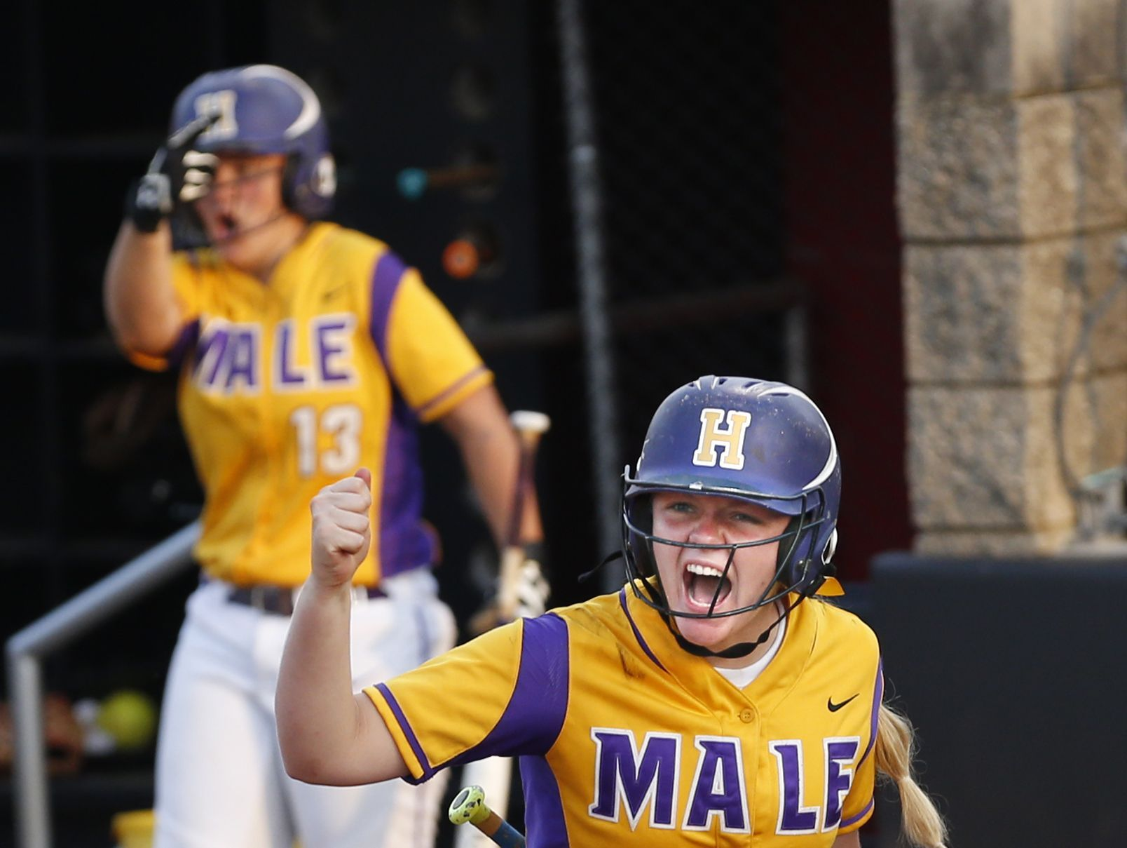 Male's Bayleigh Masterson celebrates after the Bulldogs go up 2-0 over Ballard. June 1, 2016