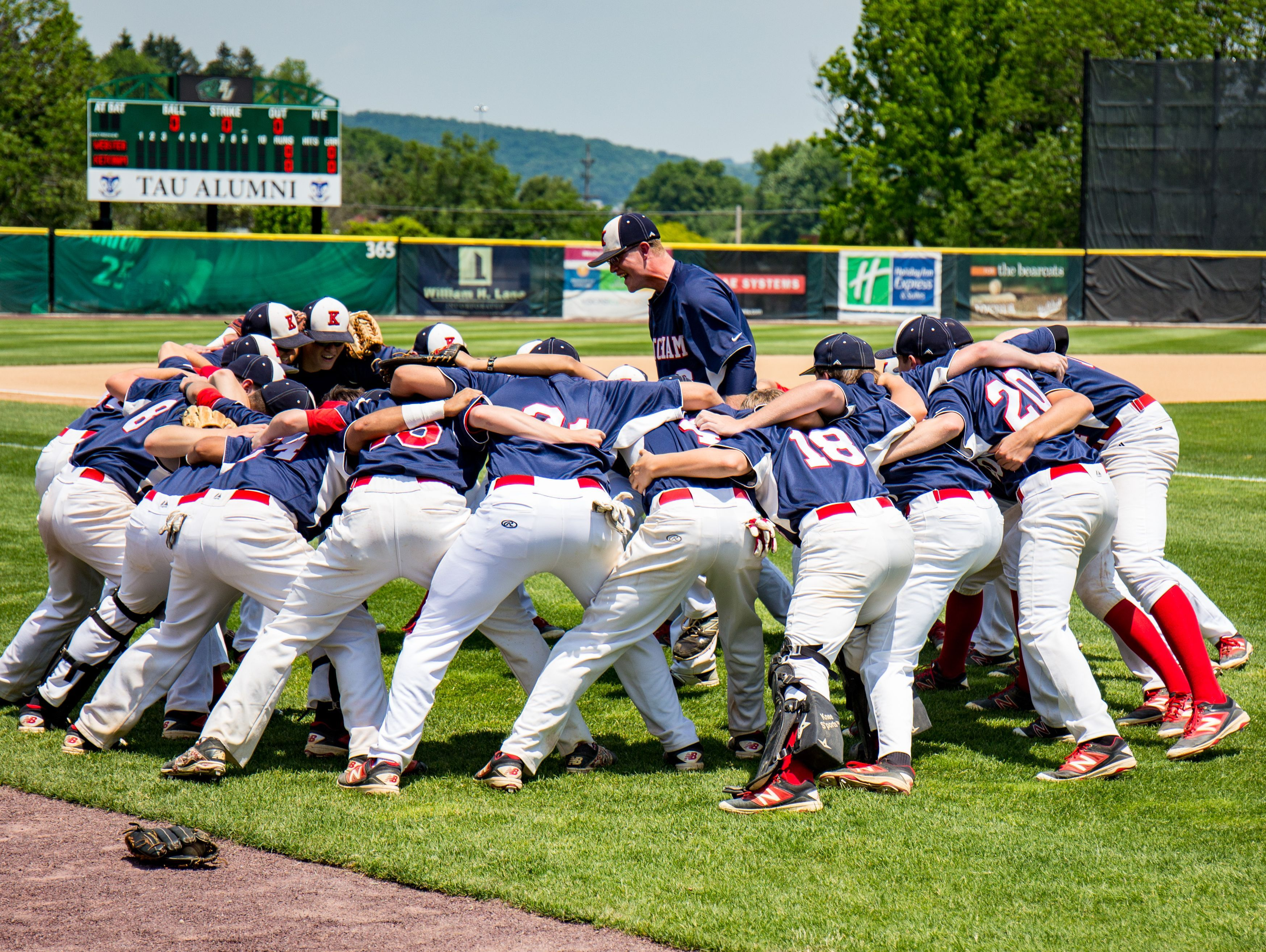 The Roy C. Ketcham baseball team works itself into a frenzy before its state Class AA semifinal loss to Webster Schroeder on June 11.