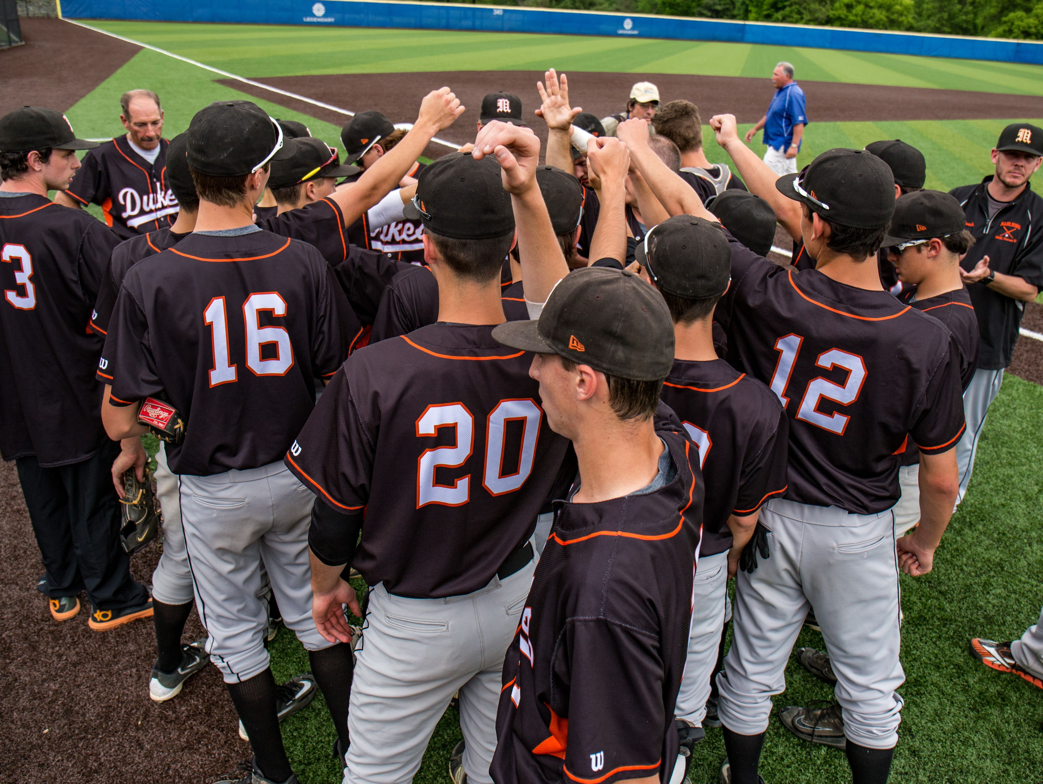 In this file photo from June 11, 2016, Marlboro High School's baseball team huddles before the Class B state semifinal in Endwell. The Iron Dukes began this season with a 10-0 win over Highland Thursday.
