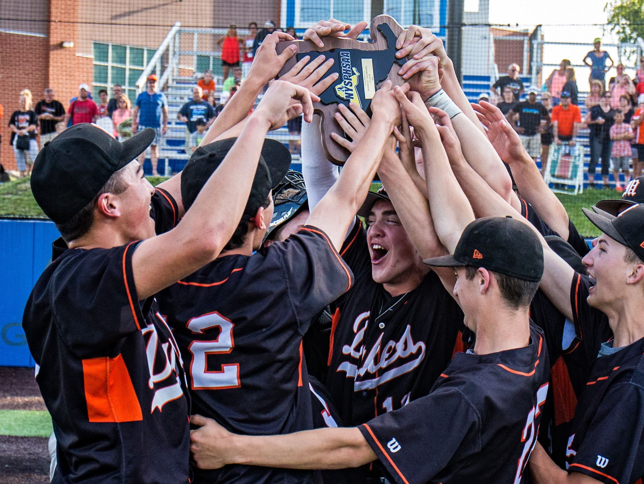 In this June 11, 2016 file photo, Marlboro High School's baseball team celebrates with the state Class B trophy in Endwell.