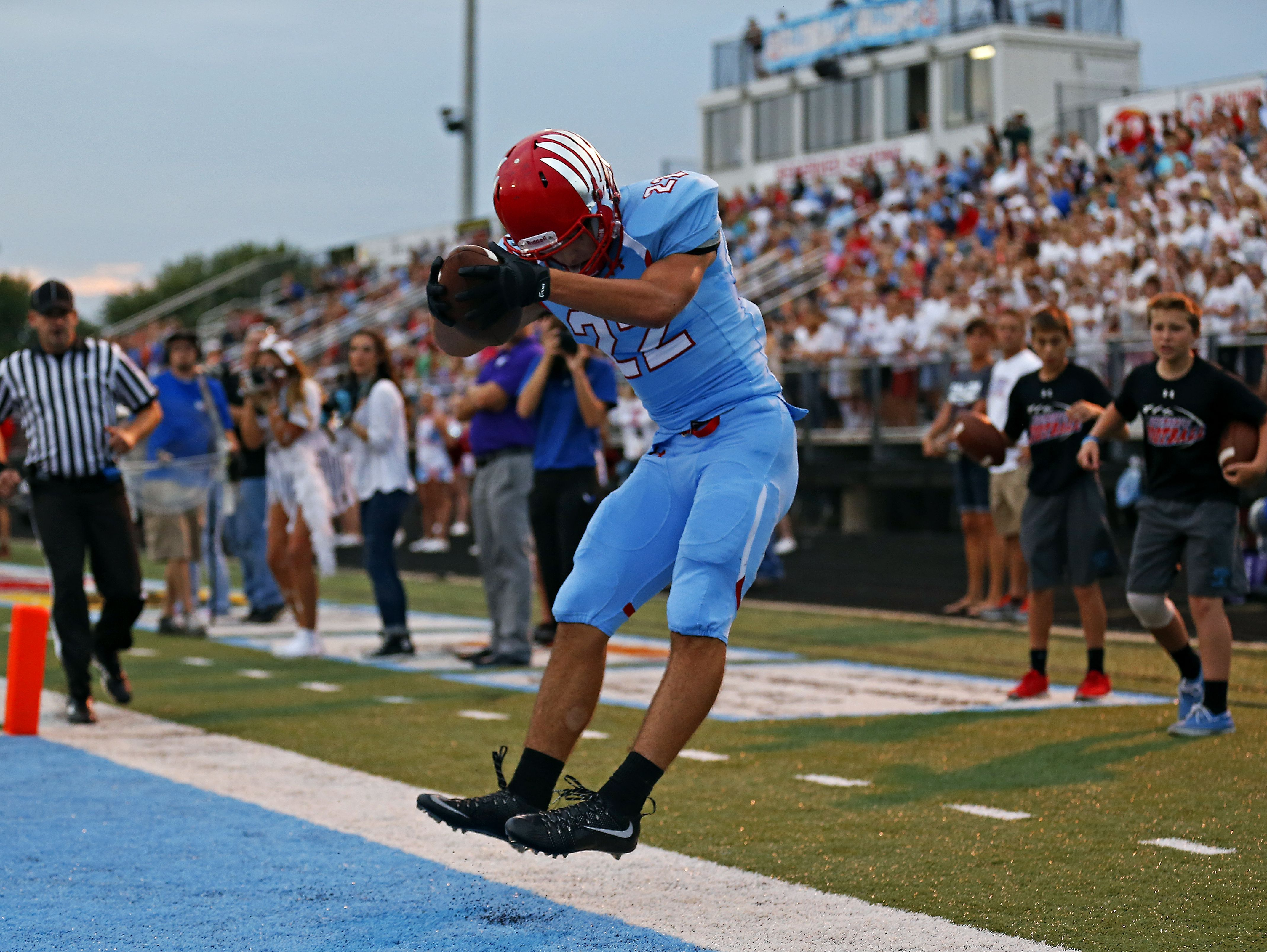 Glendale High School wide receiver Luke Montgomery (22) catches a touchdown pass during first quarter action of the Falcons' game against Hillcrest High School at Lowe Stadium in Springfield, Mo. on Aug. 28, 2015.