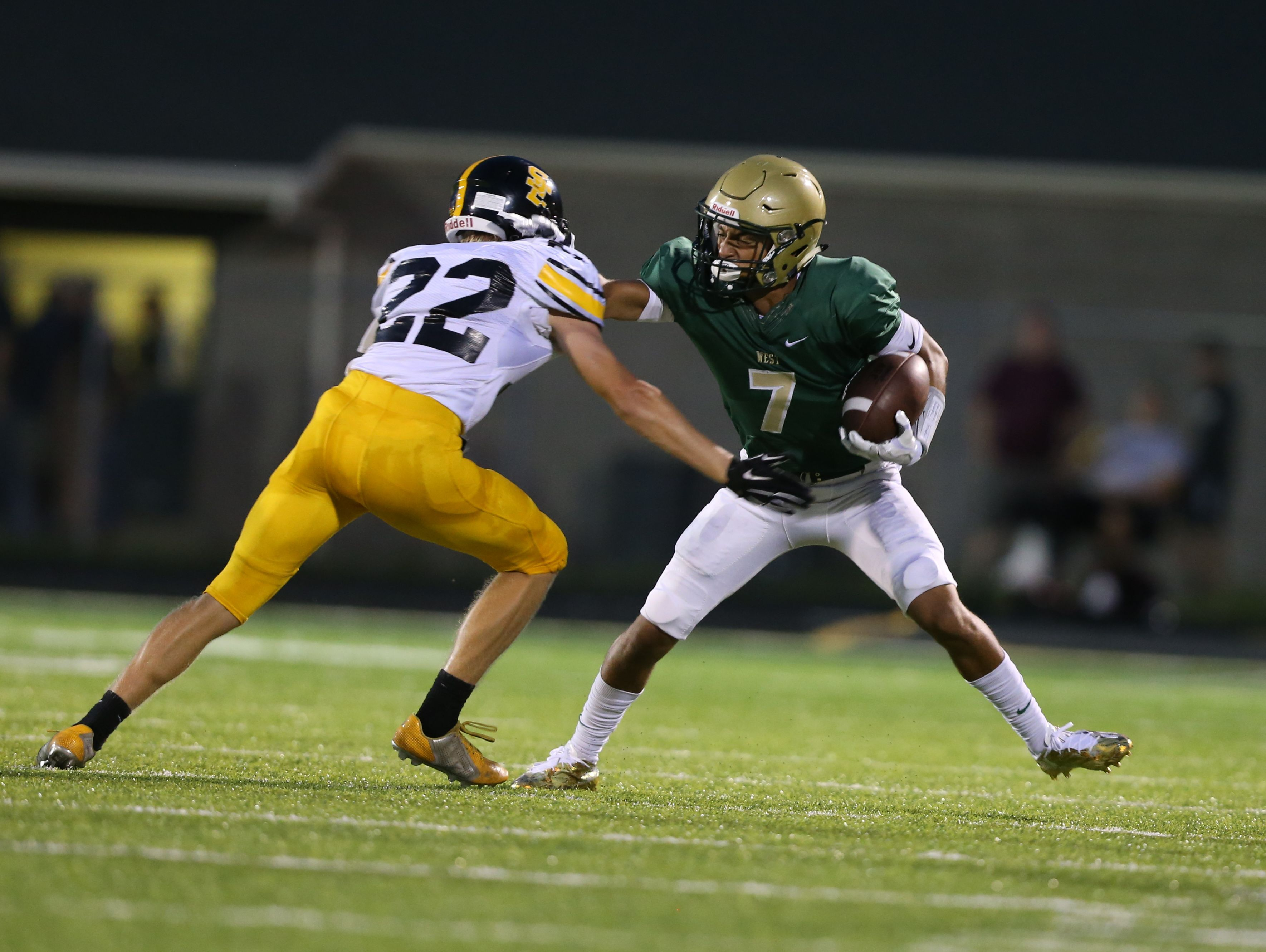 Iowa City West's Traevis Buchanan evades a defender during last week's game against Southeast Polk. The Trojans play Muscatine this Friday.