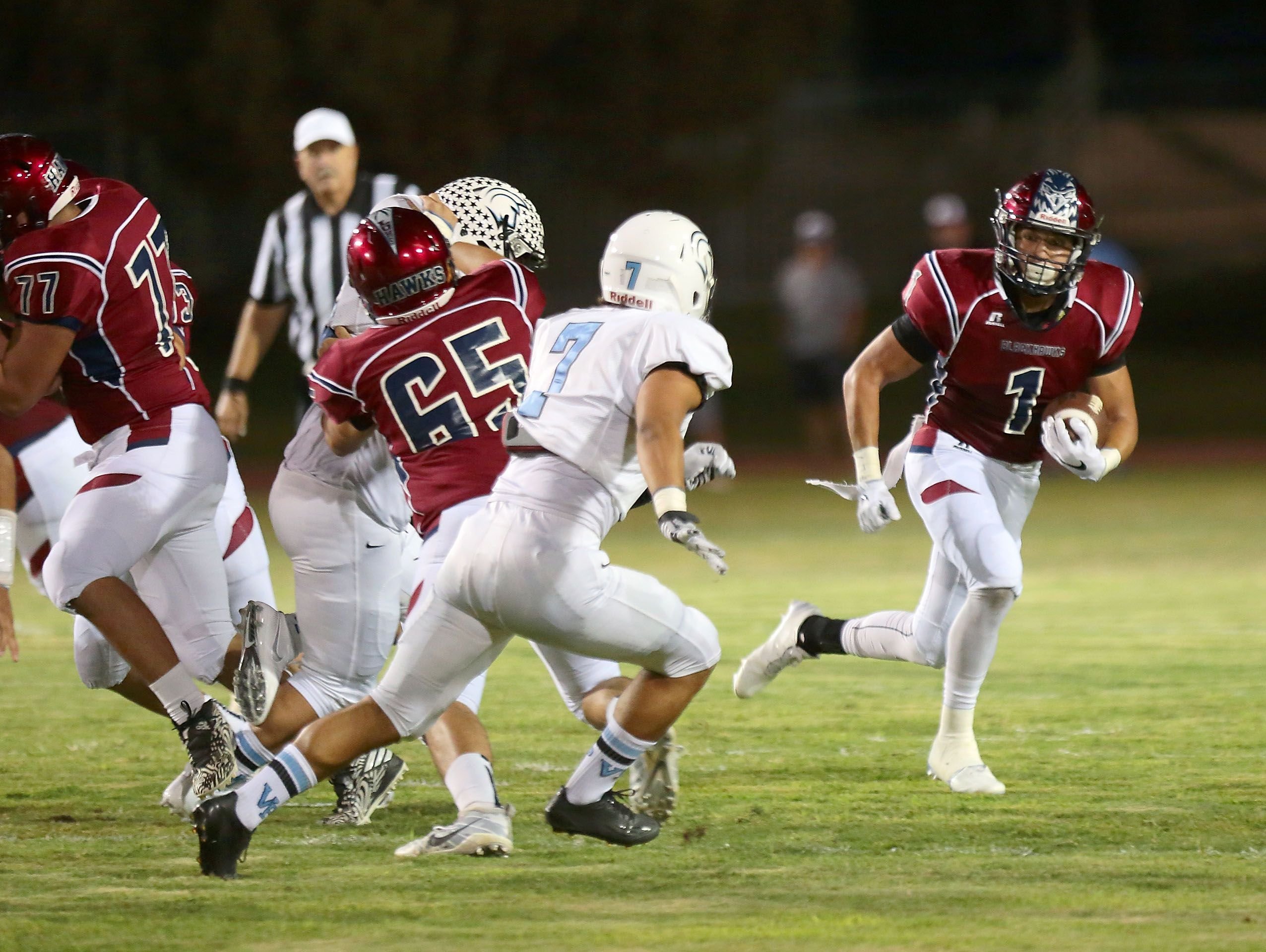 La Quinta running back Benji Cordova carries the ball early in the game before he was injured against Villa Park, September 2, 2016.