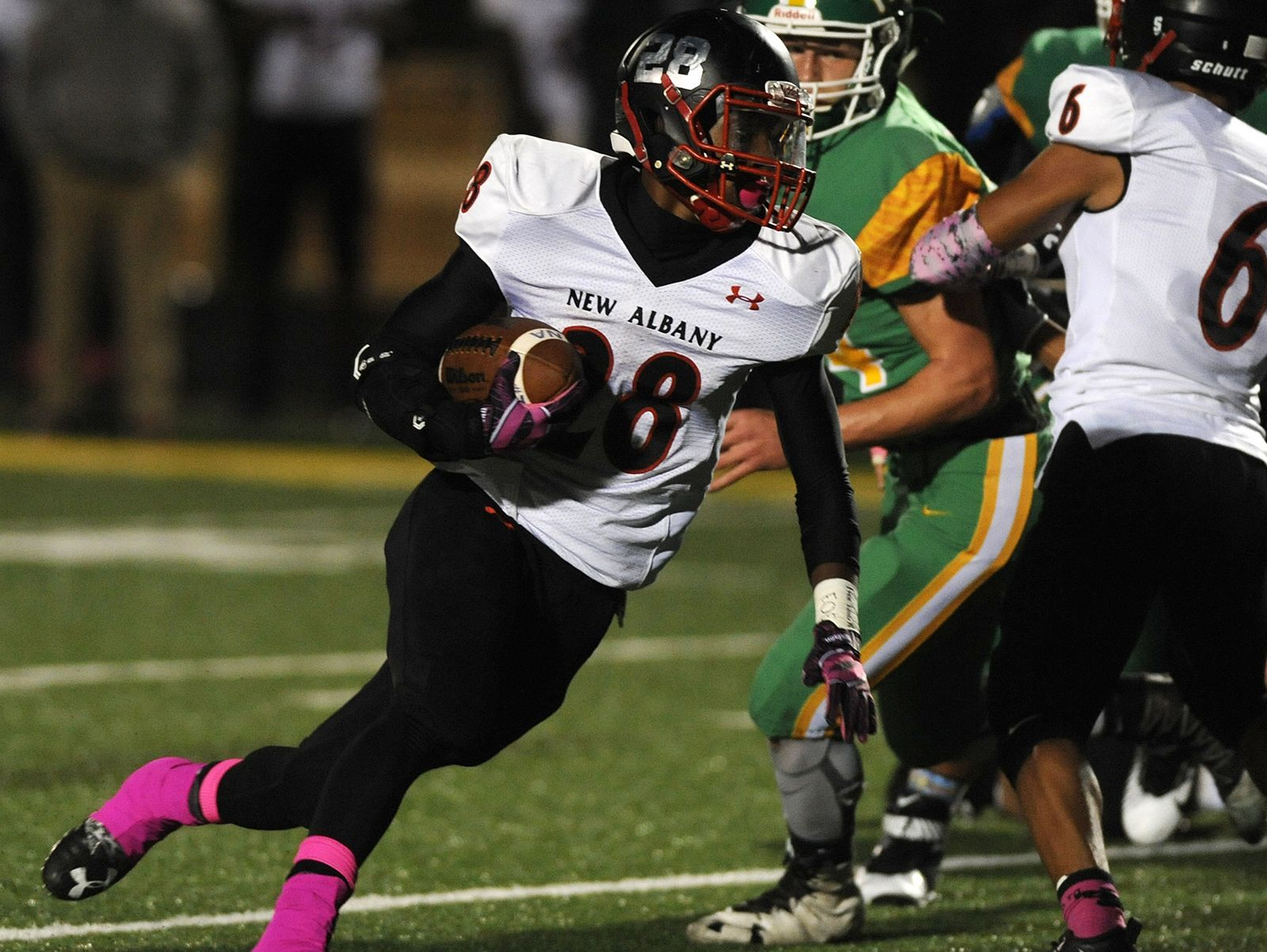 New Albany's Darquan Richardson (28) gains yardage on a run against Floyd Central on Friday at Floyd Central High School. Oct. 14, 2016