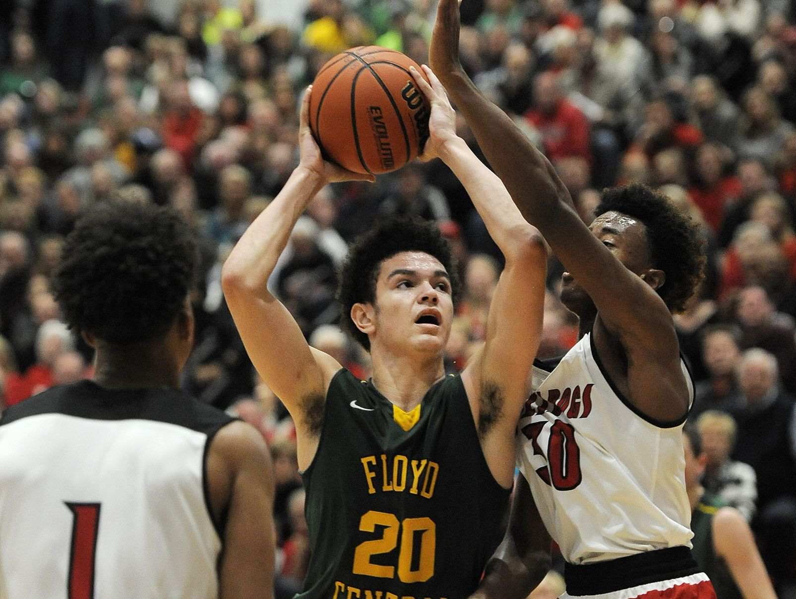 Floyd Central's Cobie Barnes (20) drives against New Albany's Romeo Langford (left) and Julien Hunter (right) on Friday at New Albany High School. (Photo by David Lee Hartlage, Special to The Courier-Journal) Dec. 9, 2016
