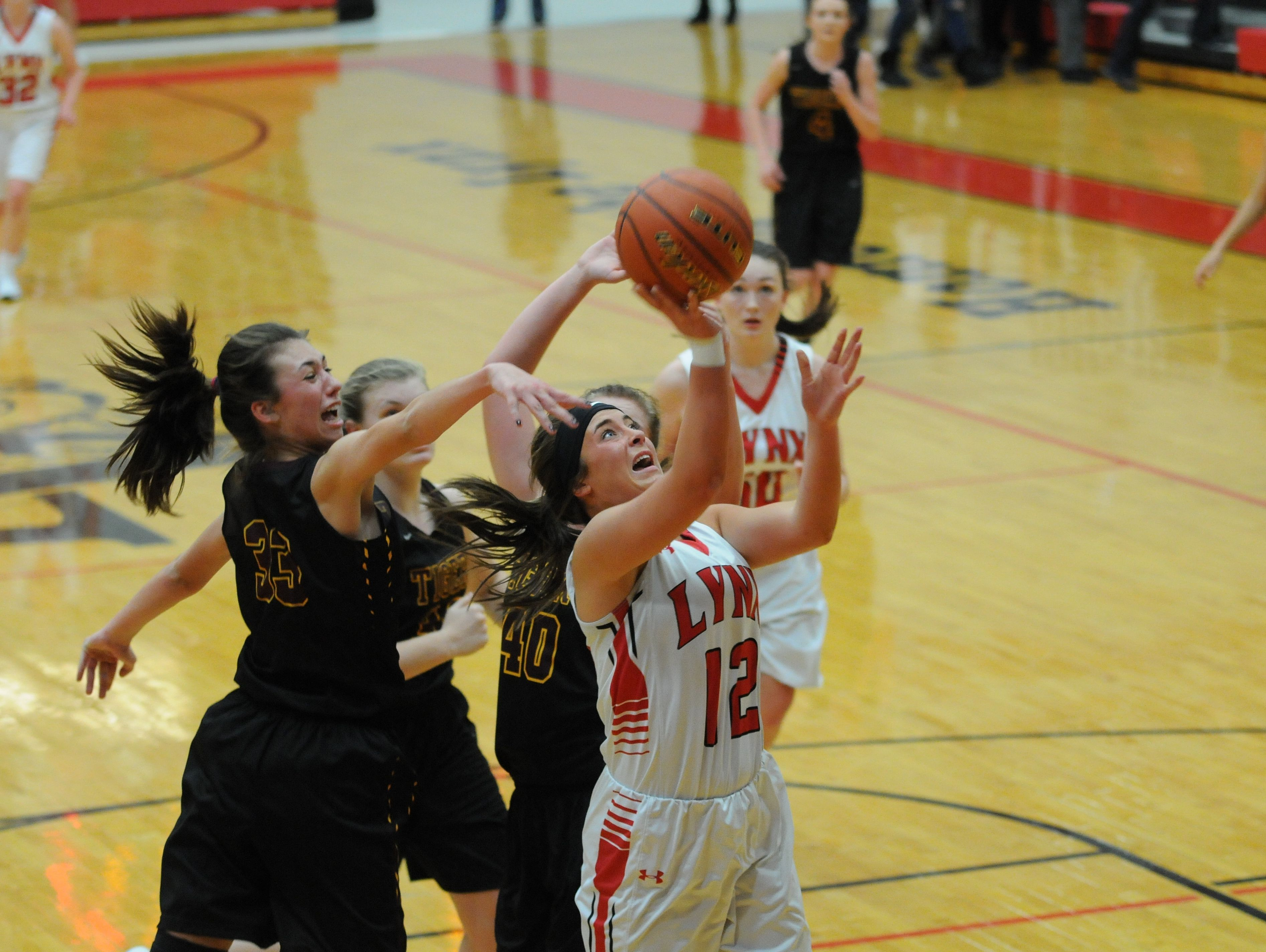 Brandon Valley's Emma Terveer #12 soars to the hoop passed a trio of Harrisburg defenders during varsity action Friday night. Brandon Valley won 65-57 in overtime.